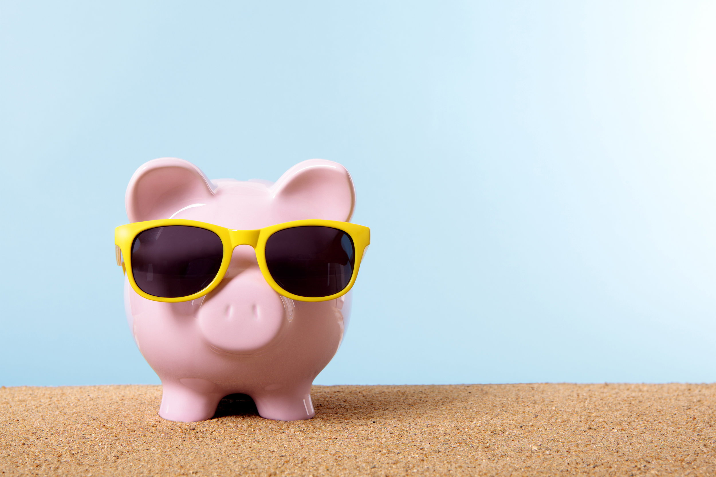 Single piggy bank yellow sunglasses with copyspace.jpg