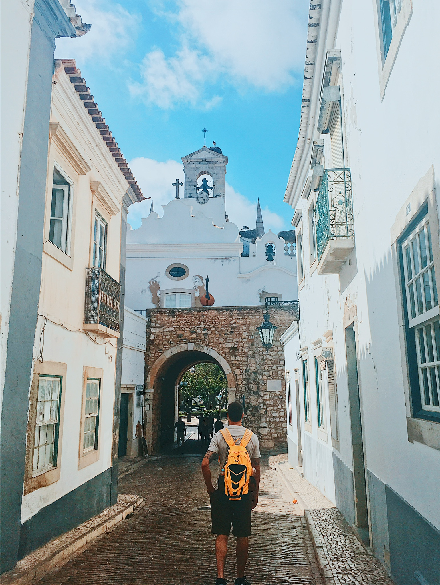 Charming Faro streets: can you see the stork standing on a nest by the bell tower?