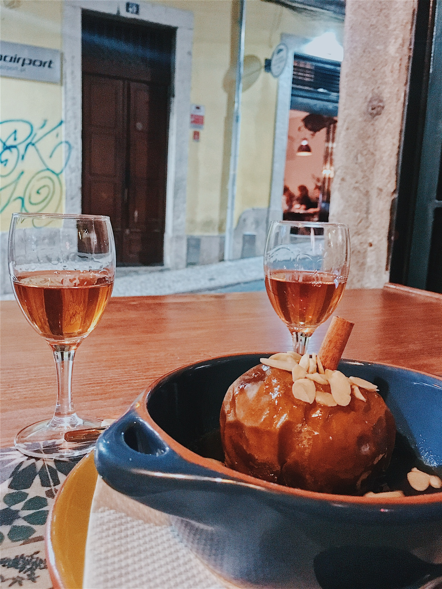 """Baked apple drenched in sweet """"jeropiga"""" liquor , served with the same liquor for you to sip on"""