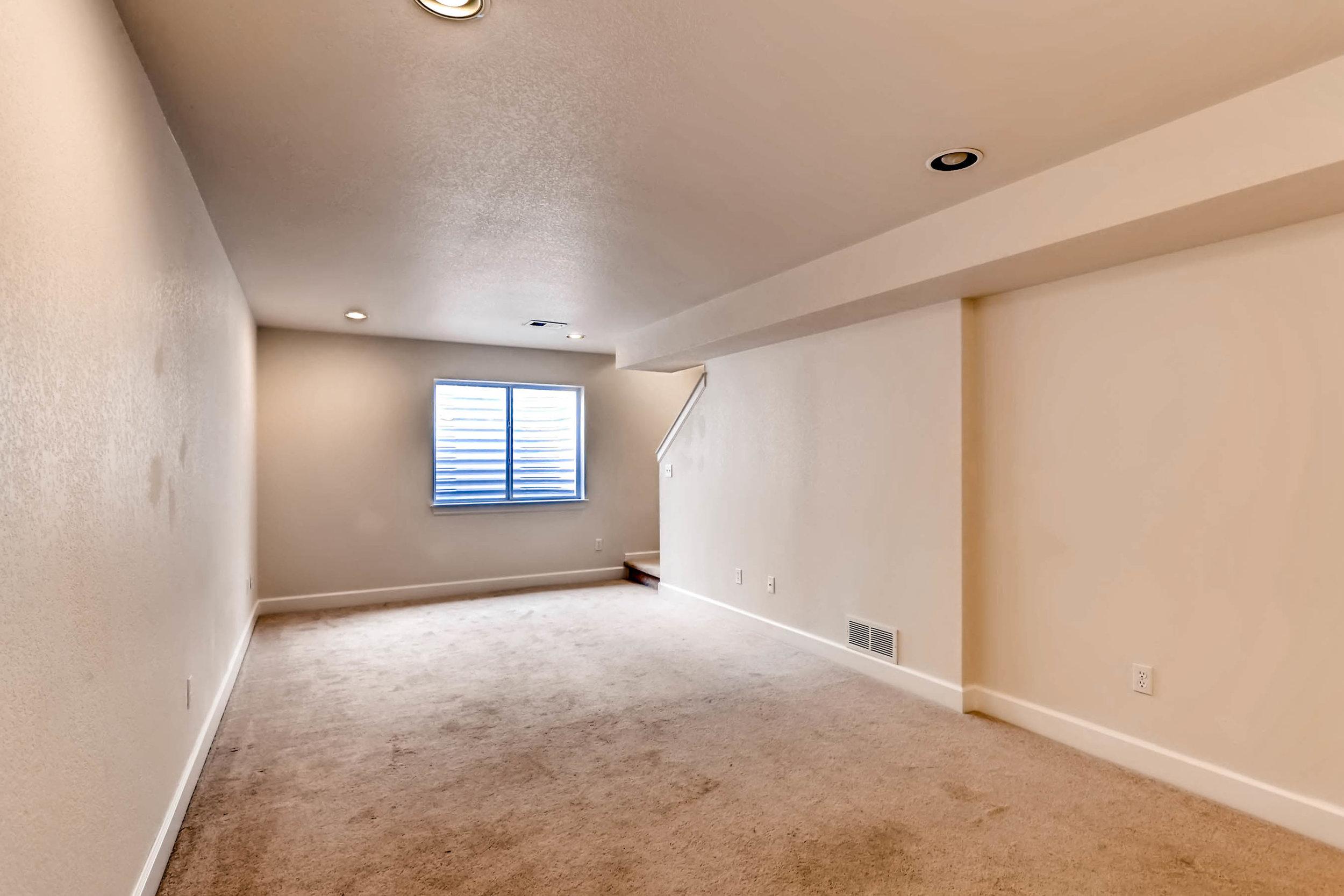1275 Hummingbird Circle A-print-023-25-Lower Level Family Room-2700x1800-300dpi.jpg