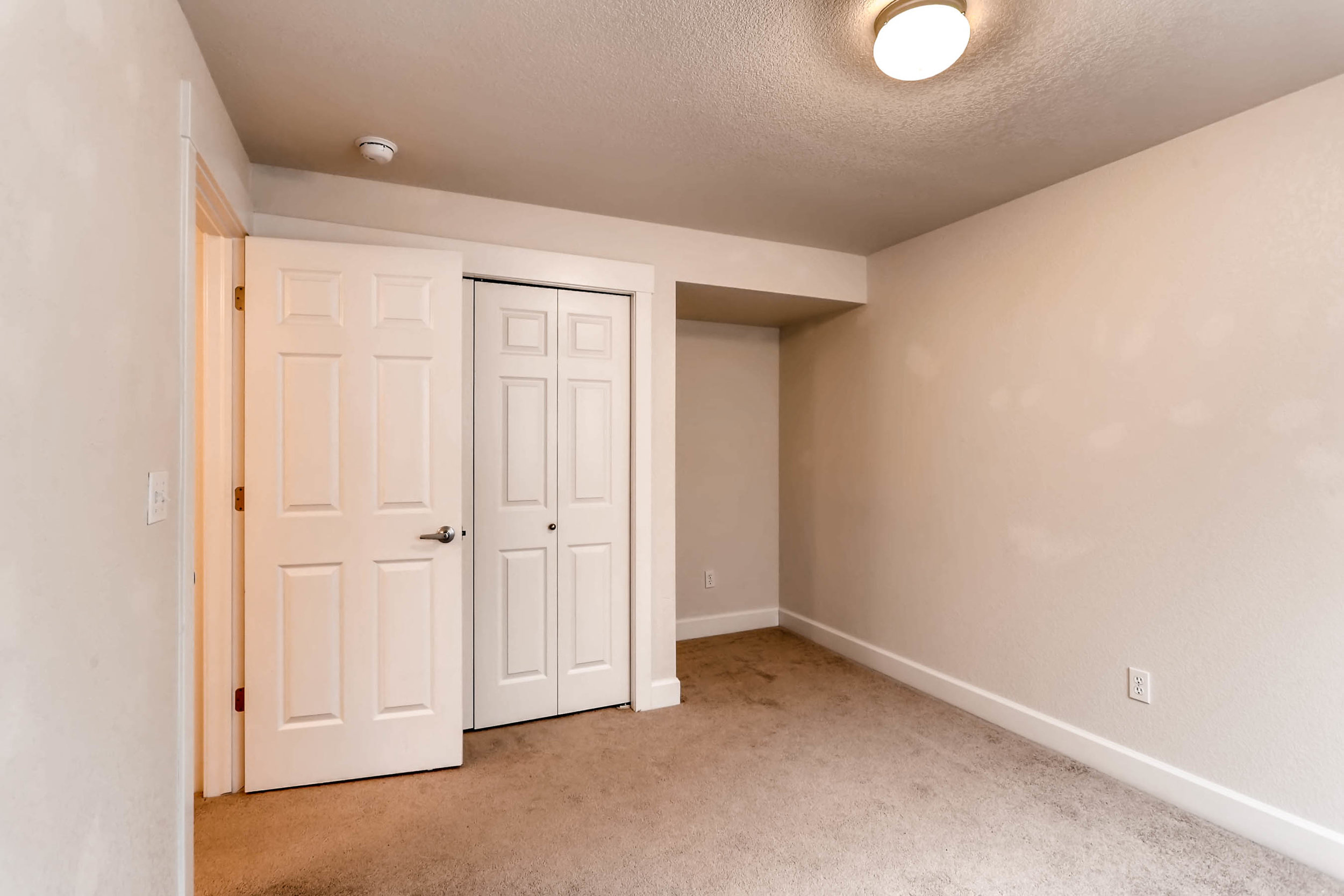1275 Hummingbird Circle A-print-024-20-Lower Level Bedroom-2700x1800-300dpi.jpg