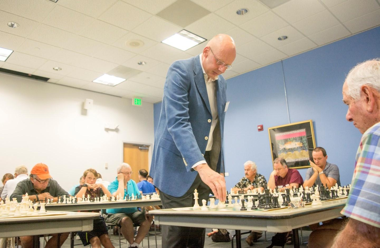 Han gives a simul at National Chess Day, photo courtesy of Han Schut