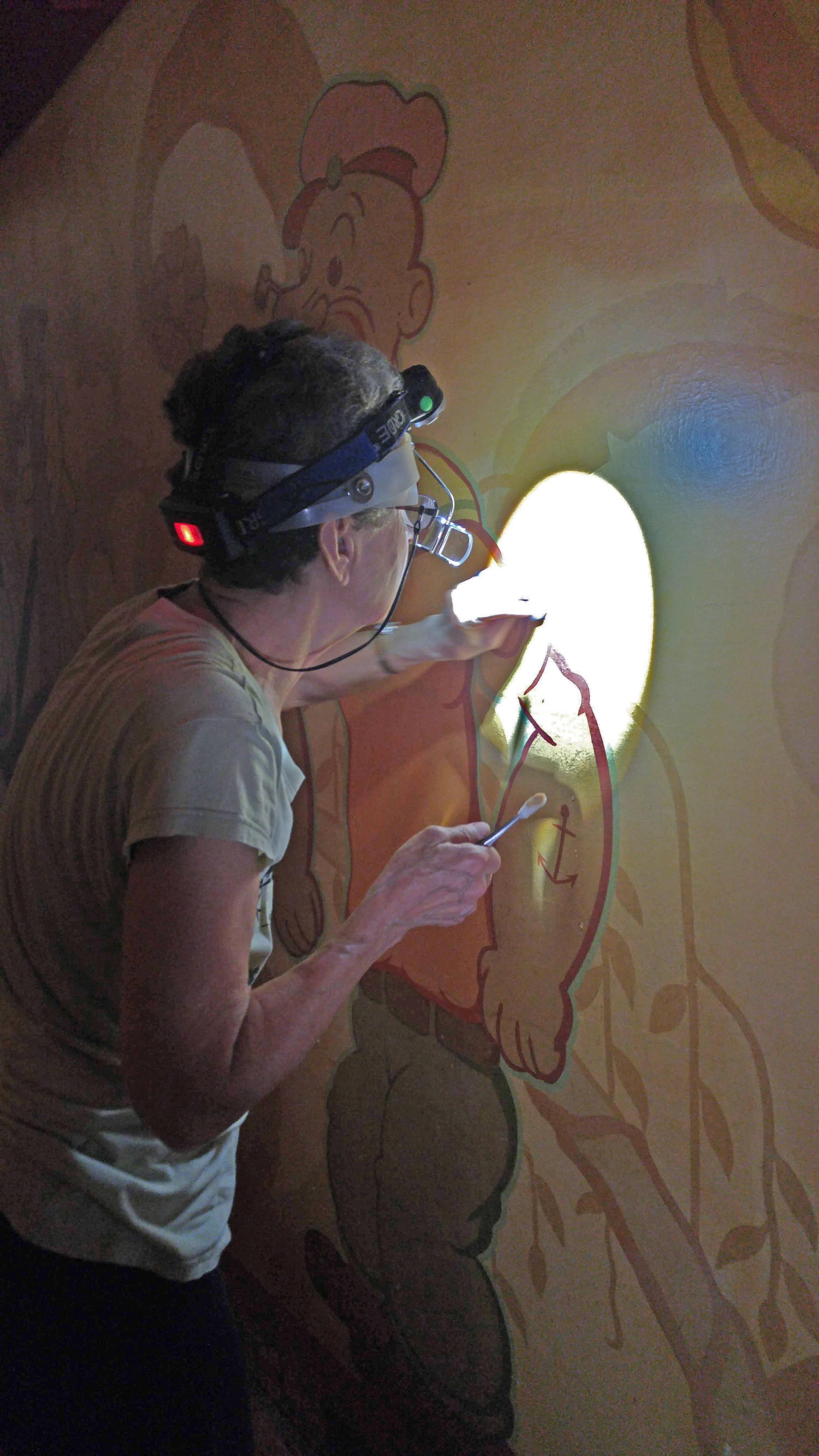 Stashka Star examines the Lakewood Theater mural.