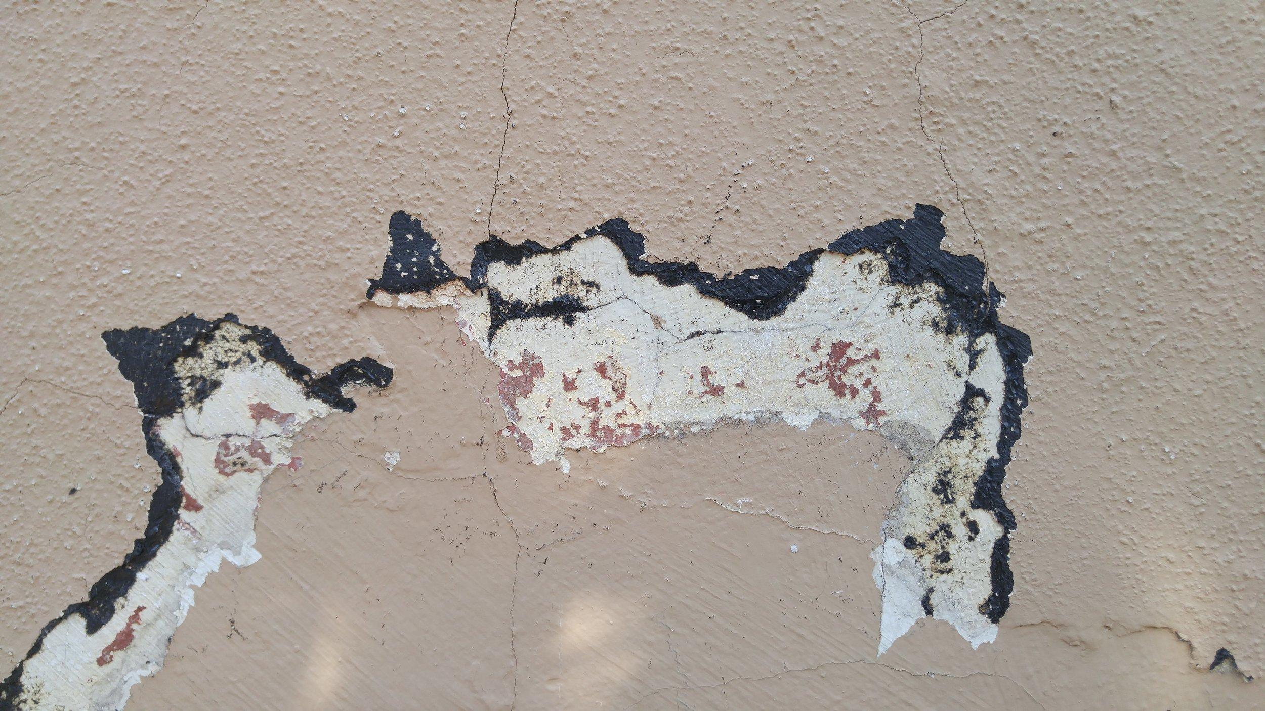 Paint scraping revealed original colors and past repairs.