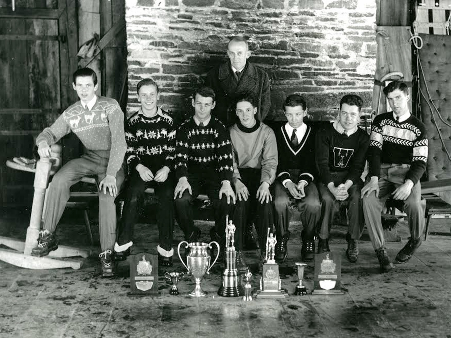 1942 Vermont Champions, taken in Gully Lodge. Back row: Coach Richard Marble Front row, left to right: Toni McManama, Bud Schoenfeld, Harry Ambrose, Harry Putney, Larry Ambrose, Vernon Cram, Bob Green.