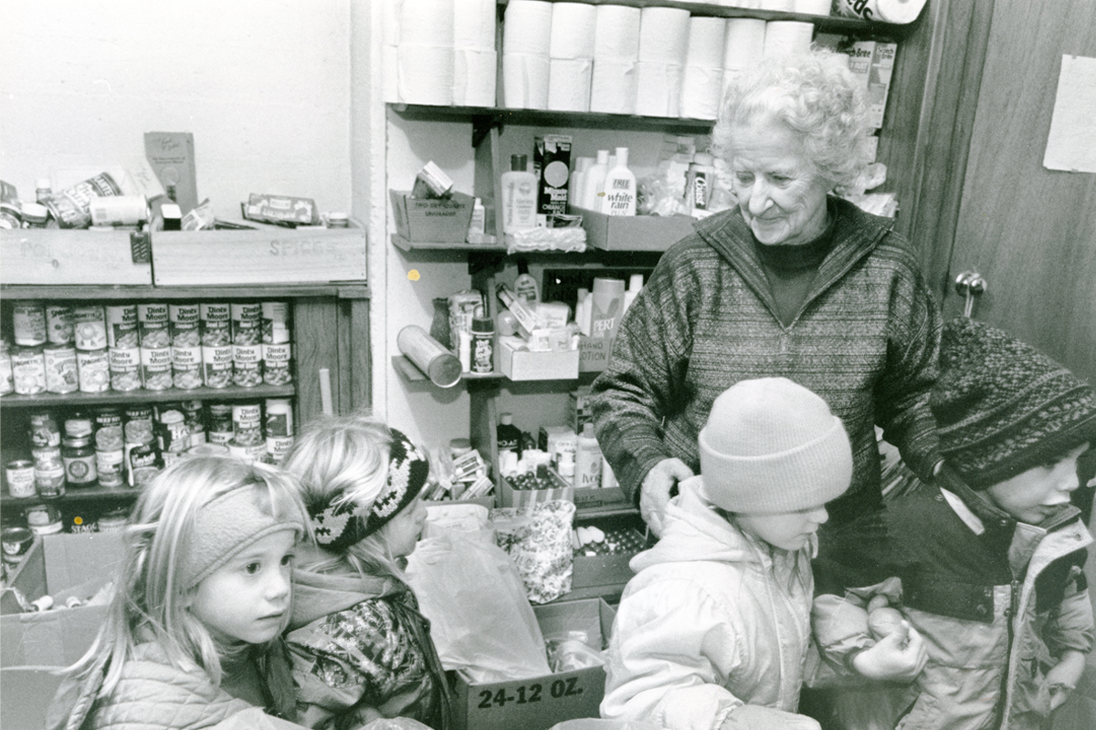 Martha at the Woodstock Community Food Shelf that she helped to establish in 1984 in the basement of St. James Episcopal Church. The Food Shelf expanded over the next four years, and in 2008, it was incorporated into a non-profit, 501(c)(3) registered with the IRS. In 2009, the Food Shelf moved to its own quarters at Maxham Meadow Way.