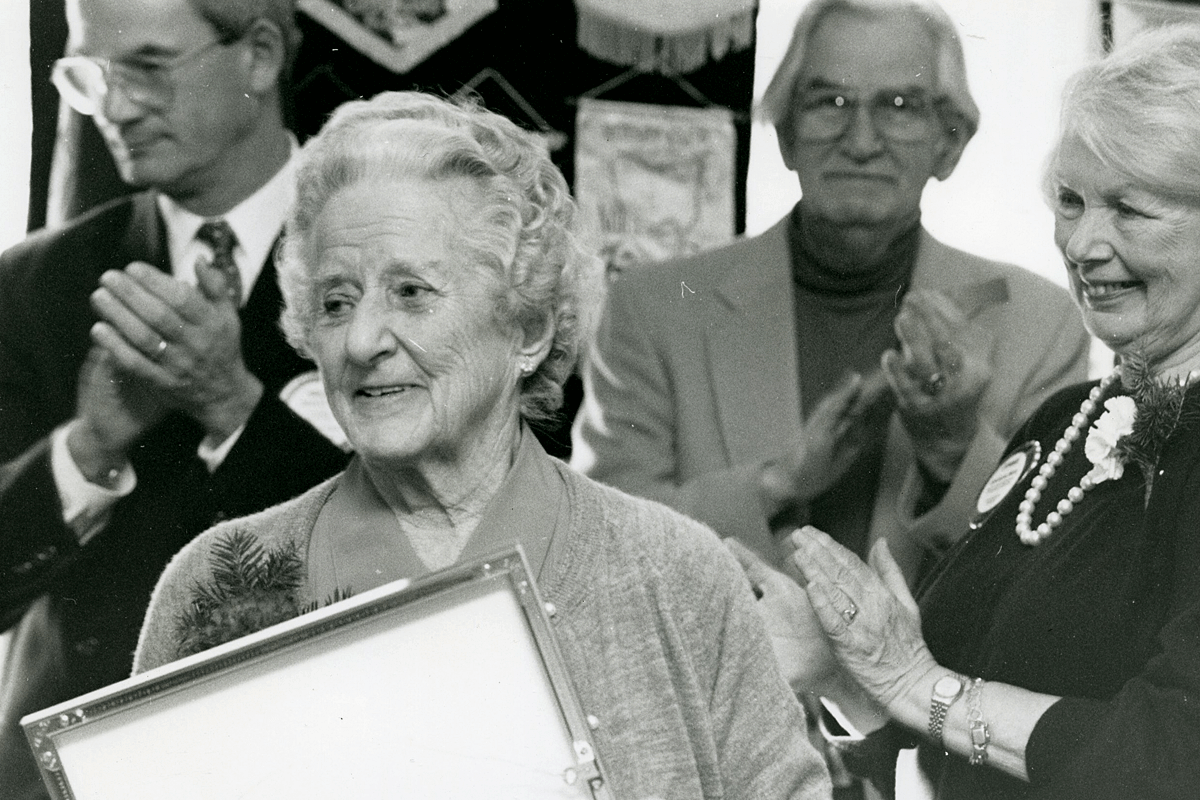 Martha receiving an award for her many contributions.