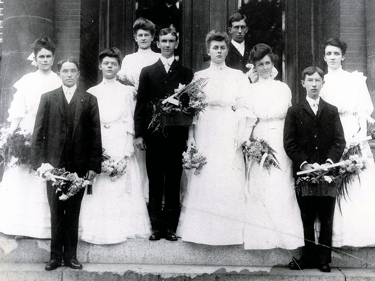 Bessie Kidder is shown with the graduating class of 1904.Bessie is in the second row, first person on the left.