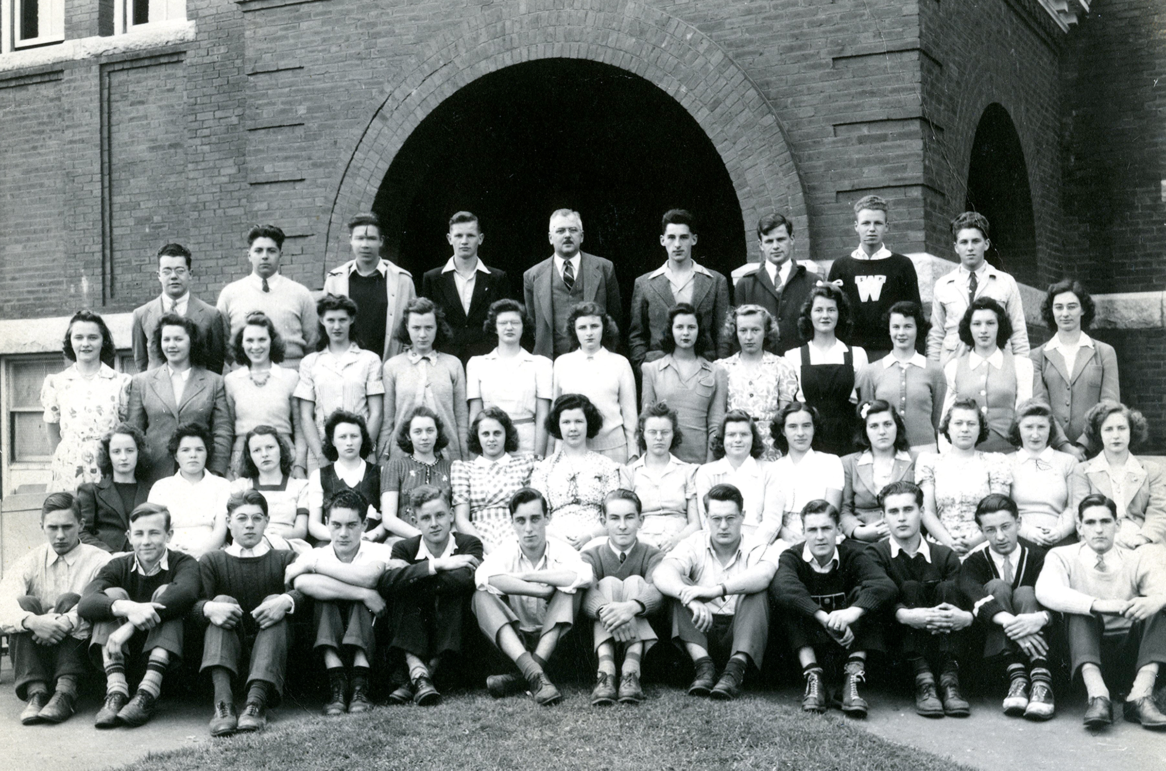 The class of 1943. Paul is in the front row, first from the right.