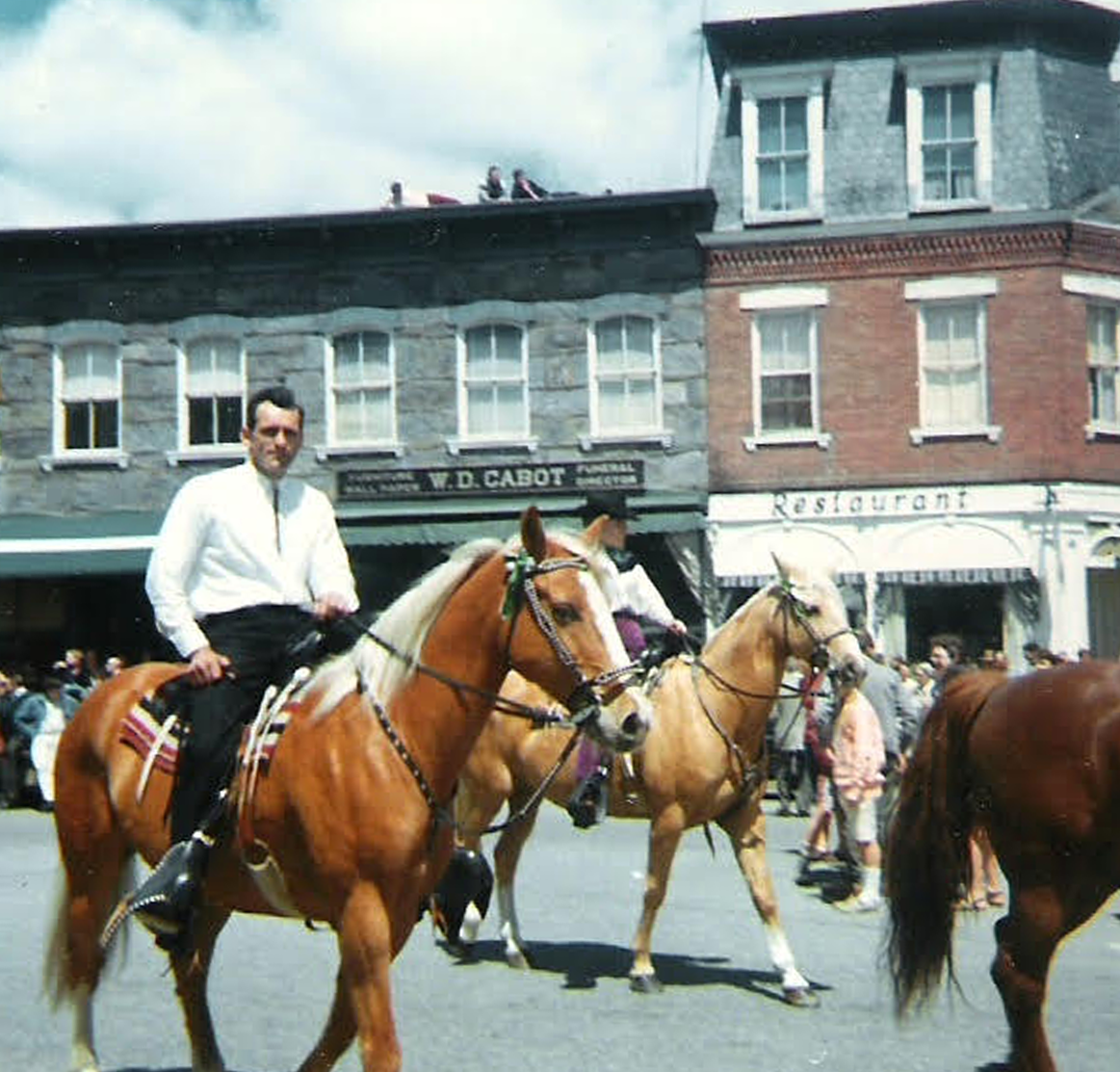 Paul riding in a Woodstock parade.