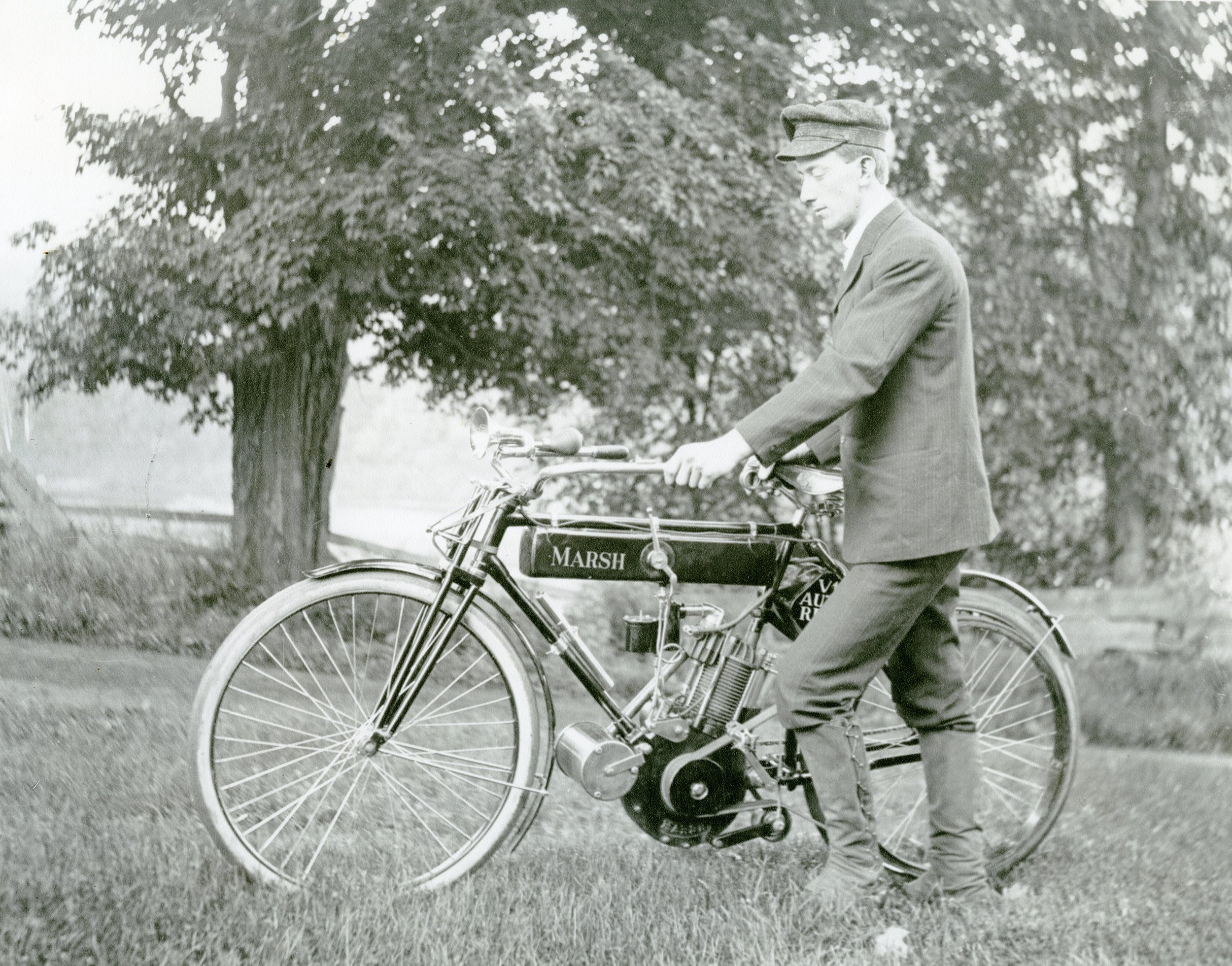 Photo of Perley Thomas with a Marsh motorized bicycle. Circa 1904.  Collection of the Woodstock History Center.