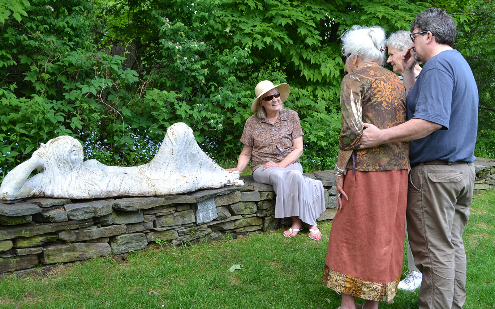 """Barbara Kaufman views her sculpture """"Reclining White Lady"""" with Charlet Davenport, Mimi Baird, and Dave Sawyer"""