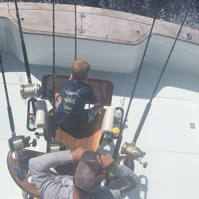 Check out these two boys going at it ! Oh 20-25 knot SW wind no problem ! Fishing continues to be great ledge fishing mixed bag dolphins in the deep . #takeakidfishing #tolerscovemarina #anothersalty day #charlestonfishing #polebenders #seahoundfishing #seakeeper