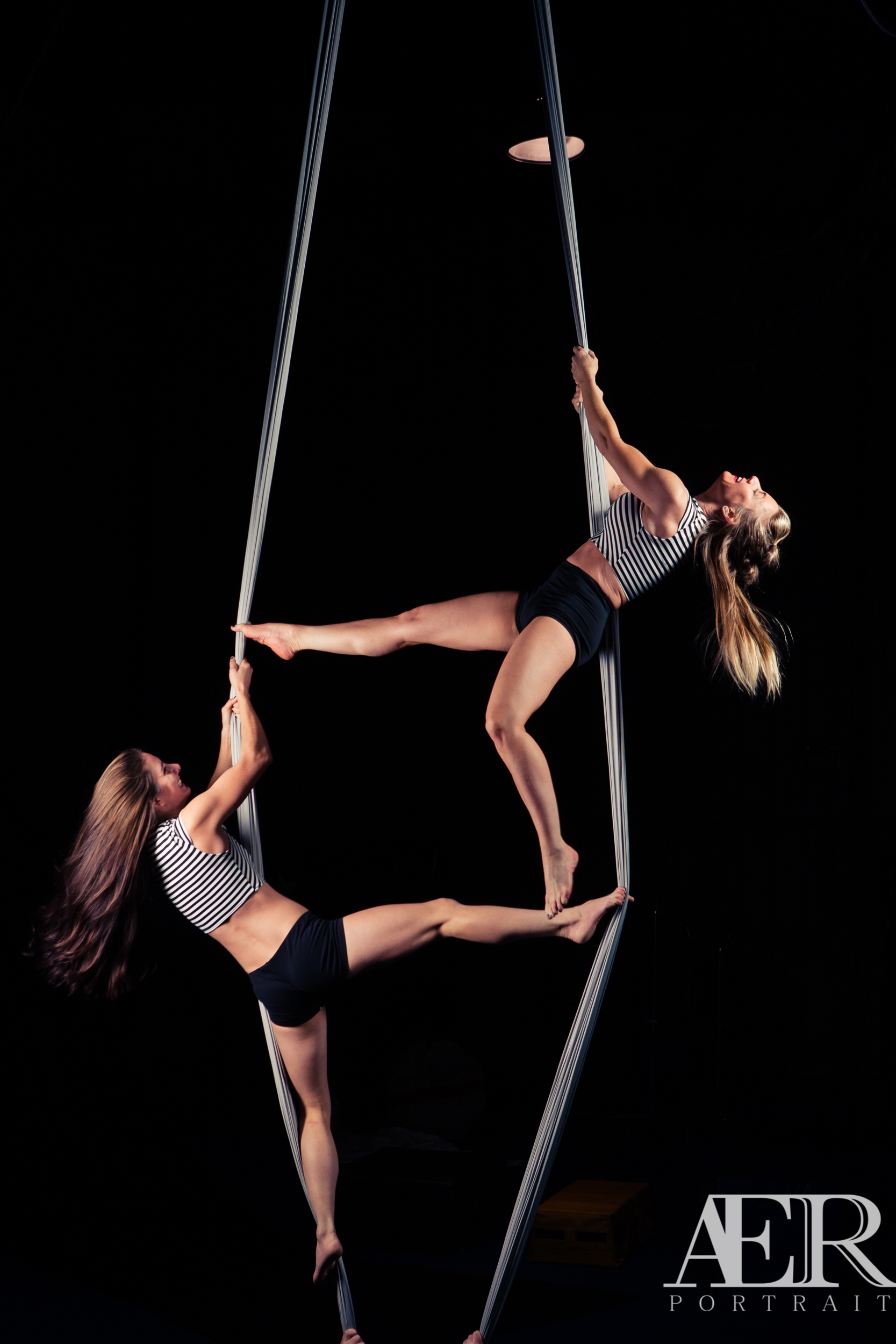 Abbie and Laura trying to get into a duo silks move.  They both have some of the strongest toes I've ever seen!