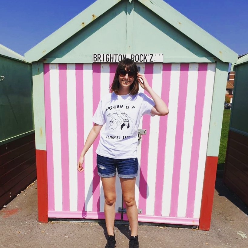 Me showing off my Revival Collective T-Shirt in front of the insta famous Hove beach huts on my IG