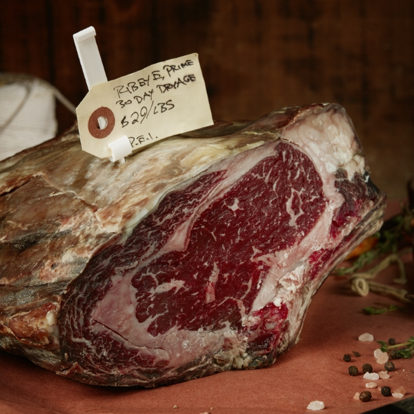 Rib loin - Grass-fed beef, naturally raised, finished on potatoes and dry aged in house. Available as bone in ribeye steak, boneless rib eye steak, cote de beuf or roast beef. Cut to order.