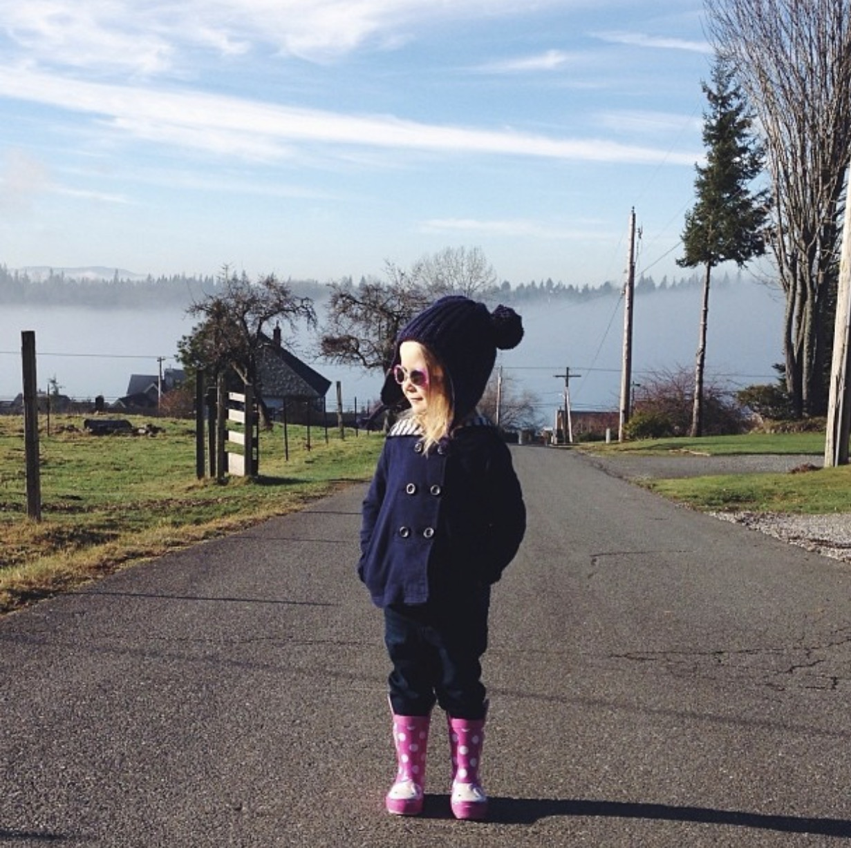 Our oldest daughter on a walk to see the cows in the Silver Beach neighborhood near Lake Whatcom.