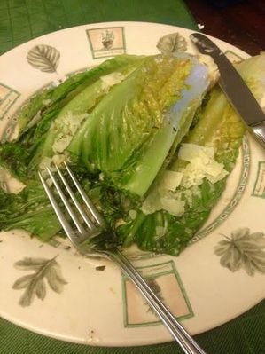 Grilled romaine with shaved Parmesan