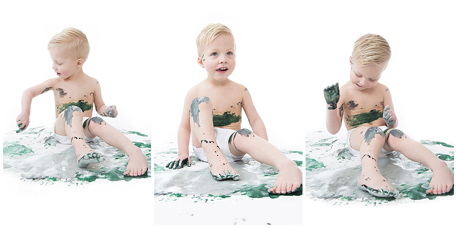 Andrea-Burolla-Photography-Denver-Childrens-photographer-kids-paint-session-little-boy-happy-playing-in-paint-green