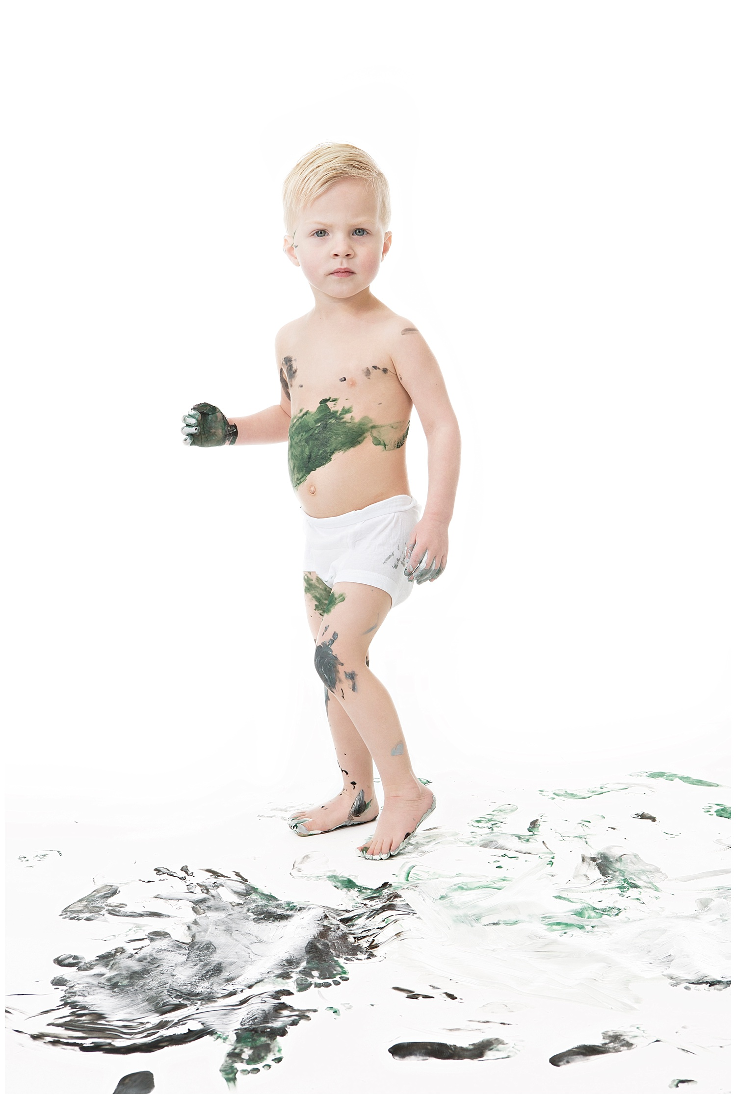 Andrea-Burolla-Photography-Denver-Childrens-photographer-kids-paint-session-little-boy-serious-playing-in-paint-green-black