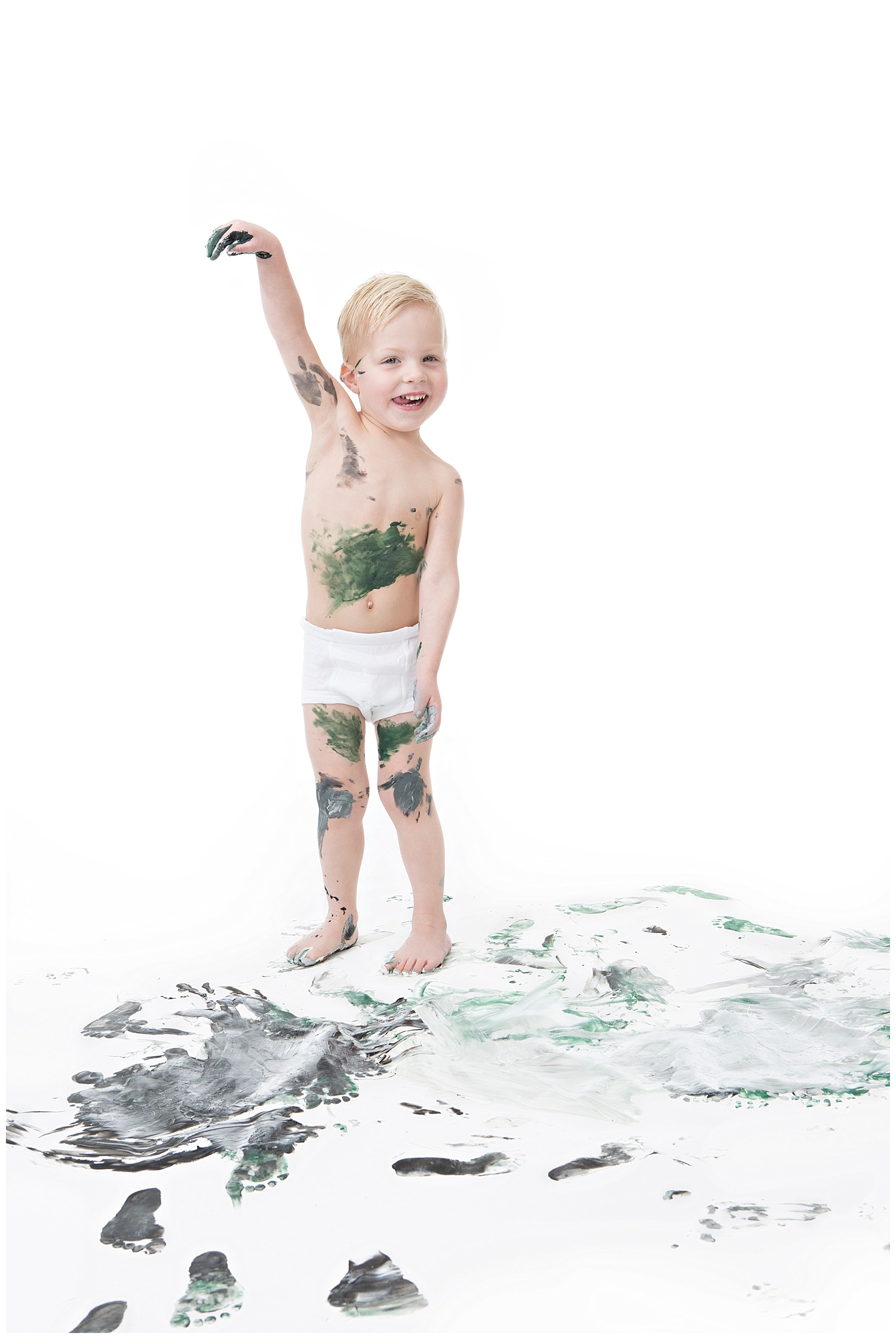 Andrea-Burolla-Photography-Denver-Childrens-photographer-kids-paint-session-little-boy-silly-playing-covered-paint-black-green