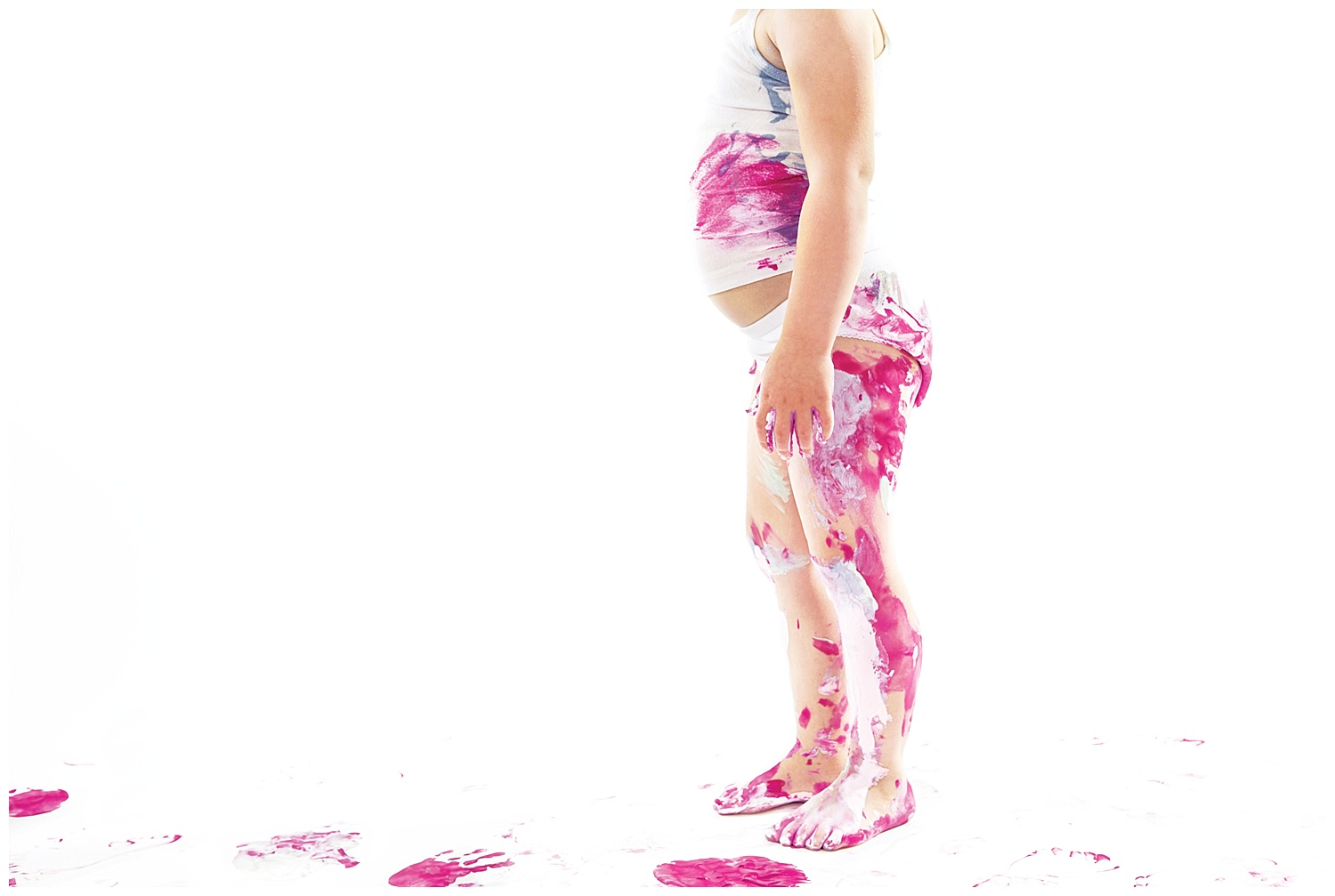 Denver-childrens-photographer-paint-session-handprints-little-girl-messy-tummy-pink