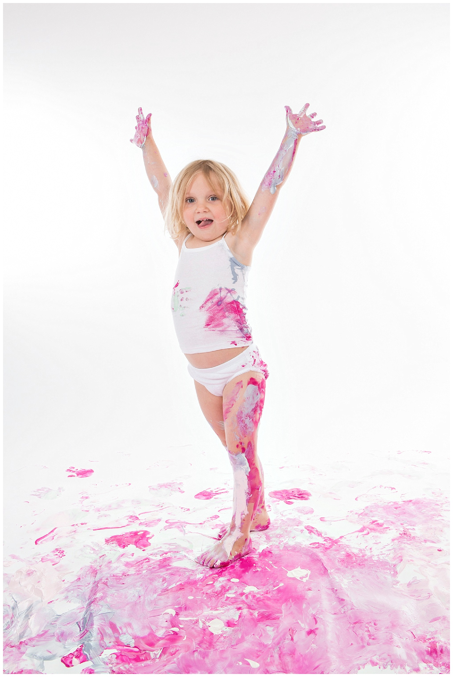 Andrea-Burolla-Photography-Denver-childrens-photographer-paint-session-happy-little-blonde-girl-pink-messy.jpg
