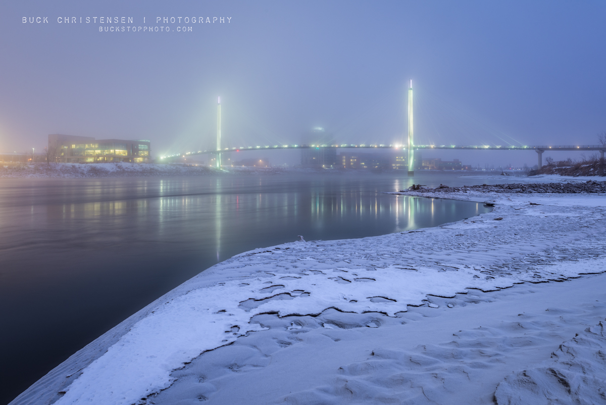 bob kerrey pedestrian bridge in the winter fog as viewed from council bluffs, iowa, omaha, nebraska