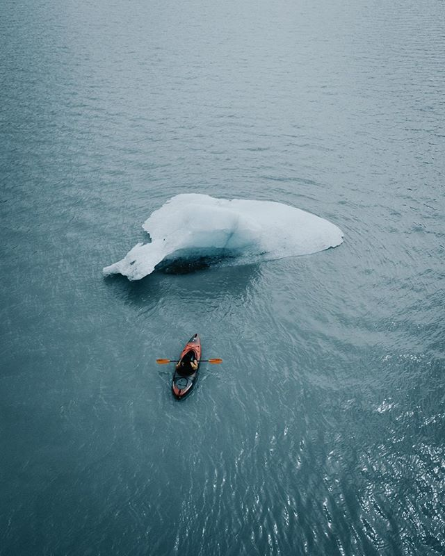 "After only a few minutes of kayaking around this bergy bit (what ""icebergs"" smaller than 16 ft tall are called), a huge piece of it fell off and floated down the river. Alaska, this wild, wild place."