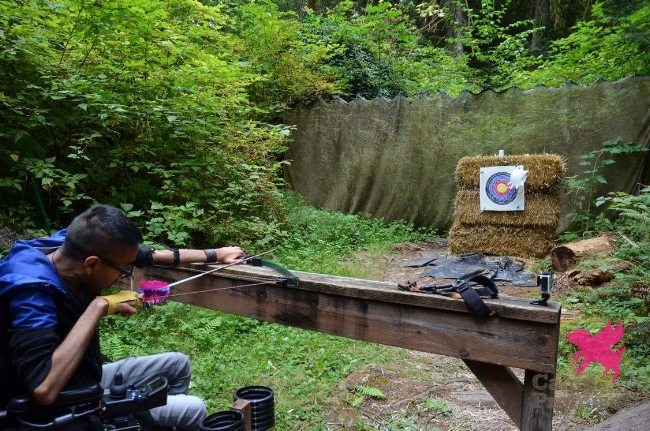 Amin at the archery range at Camp Promise-West.