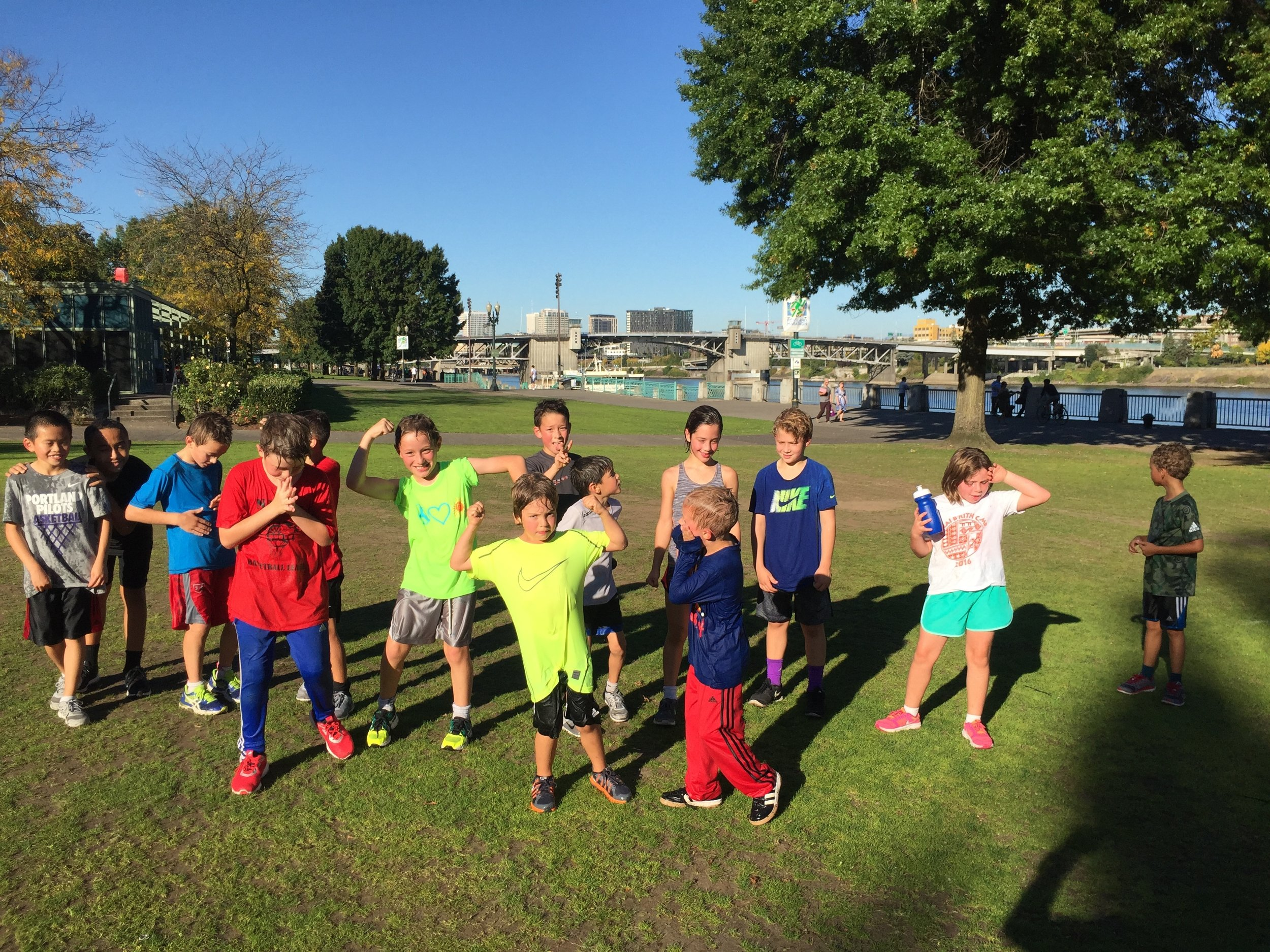 Running Club taking a breather at Waterfront Park on a beautiful Fall day.