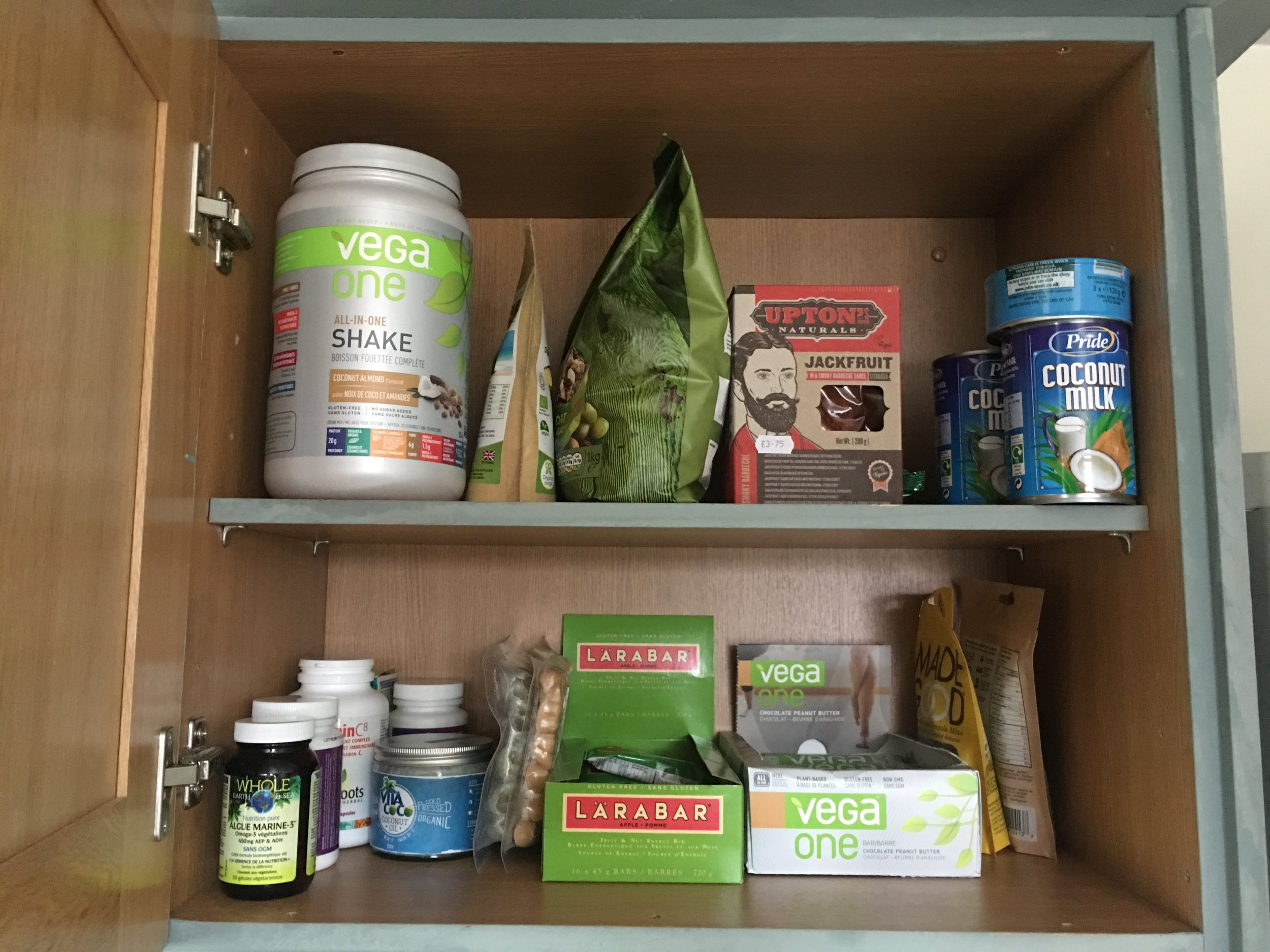 My cupboard in Wales. I brought my own supplements and also my own Vega. It's double the price in the UK, so it was worth bringing from Vancouver. Supplements are from Vita Save in North Vancouver.