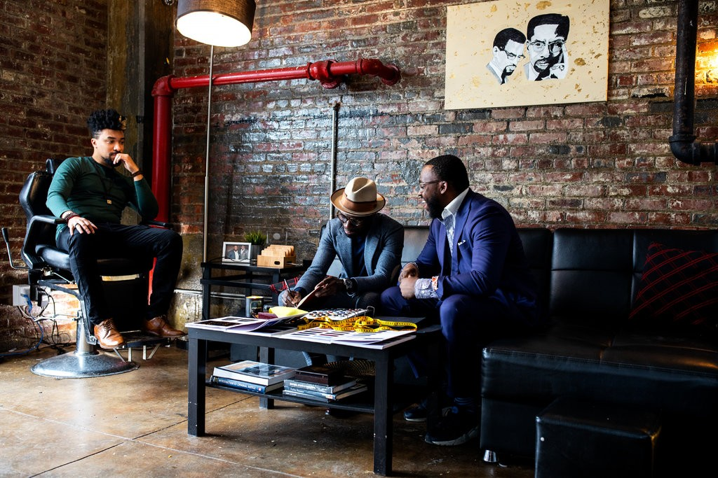 From left, Tim Jack, Prince James and Jeff Lindor at The Gentleman's Factory in Brooklyn.  Photo Credit Demetrius Freeman for The New York Times