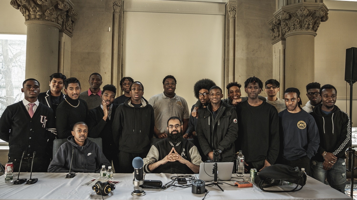 Young men from the NYC Urban Ambassadors program after participating in a Beatmaking workshop with Amjad Khan