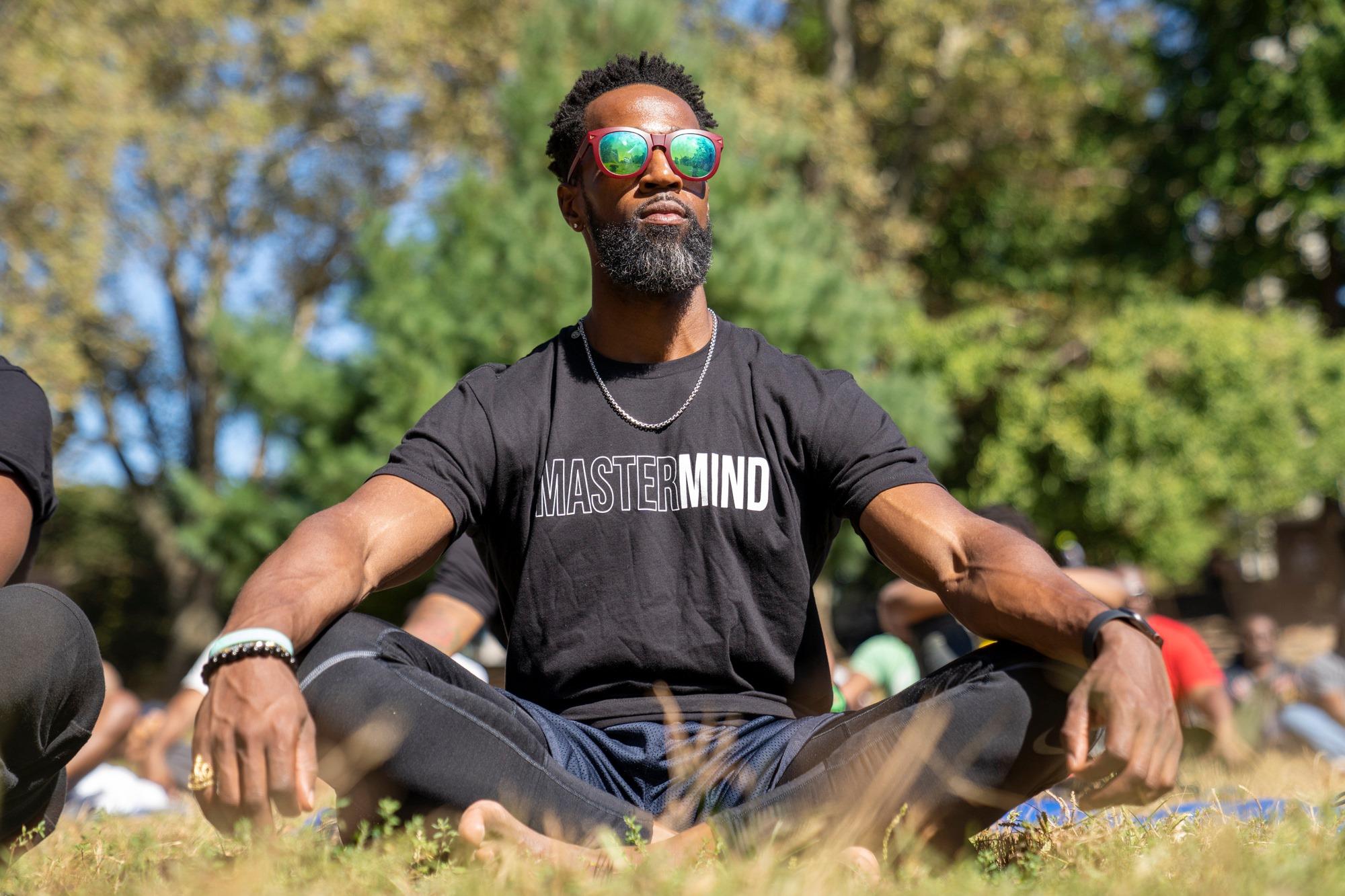 Mastermind Connect's Marlon Briscoe meditate during Omar Davis' guided meditation.