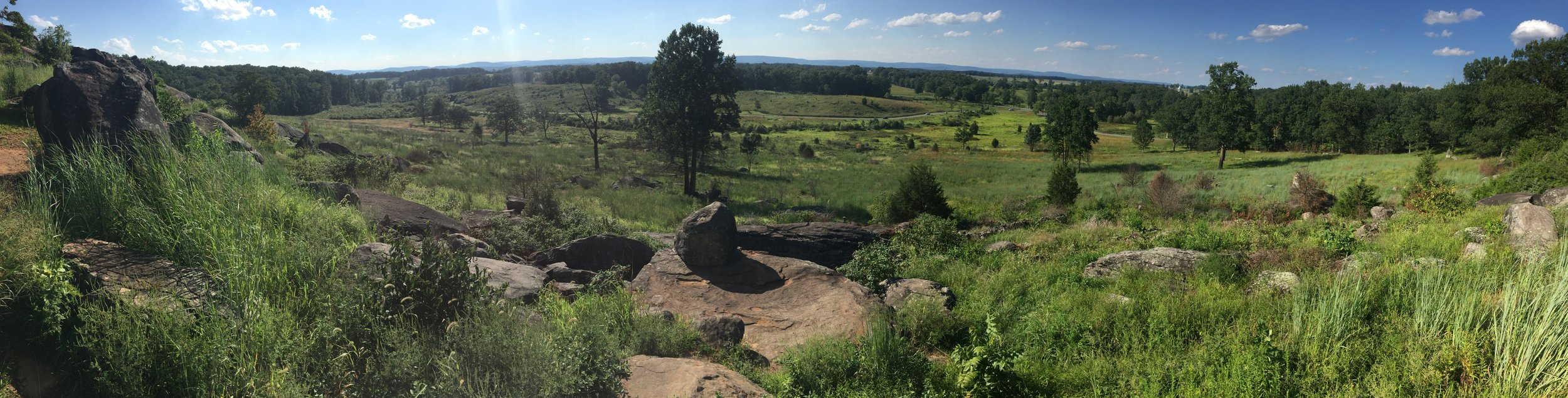 A panoramic view looking downhill from the summit of Little Round Top.