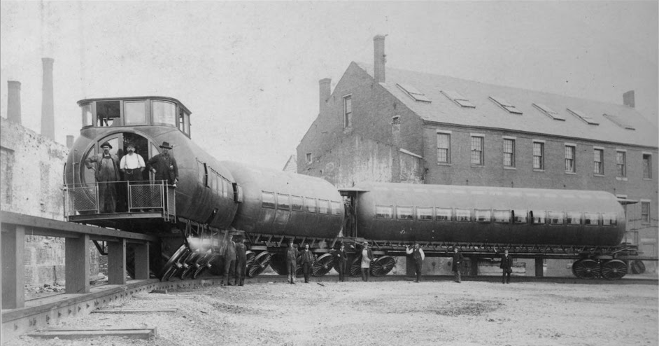 Joe_Meigs'_test_train_posed_with_its_crew_for_the_photographer_circa_1886.png