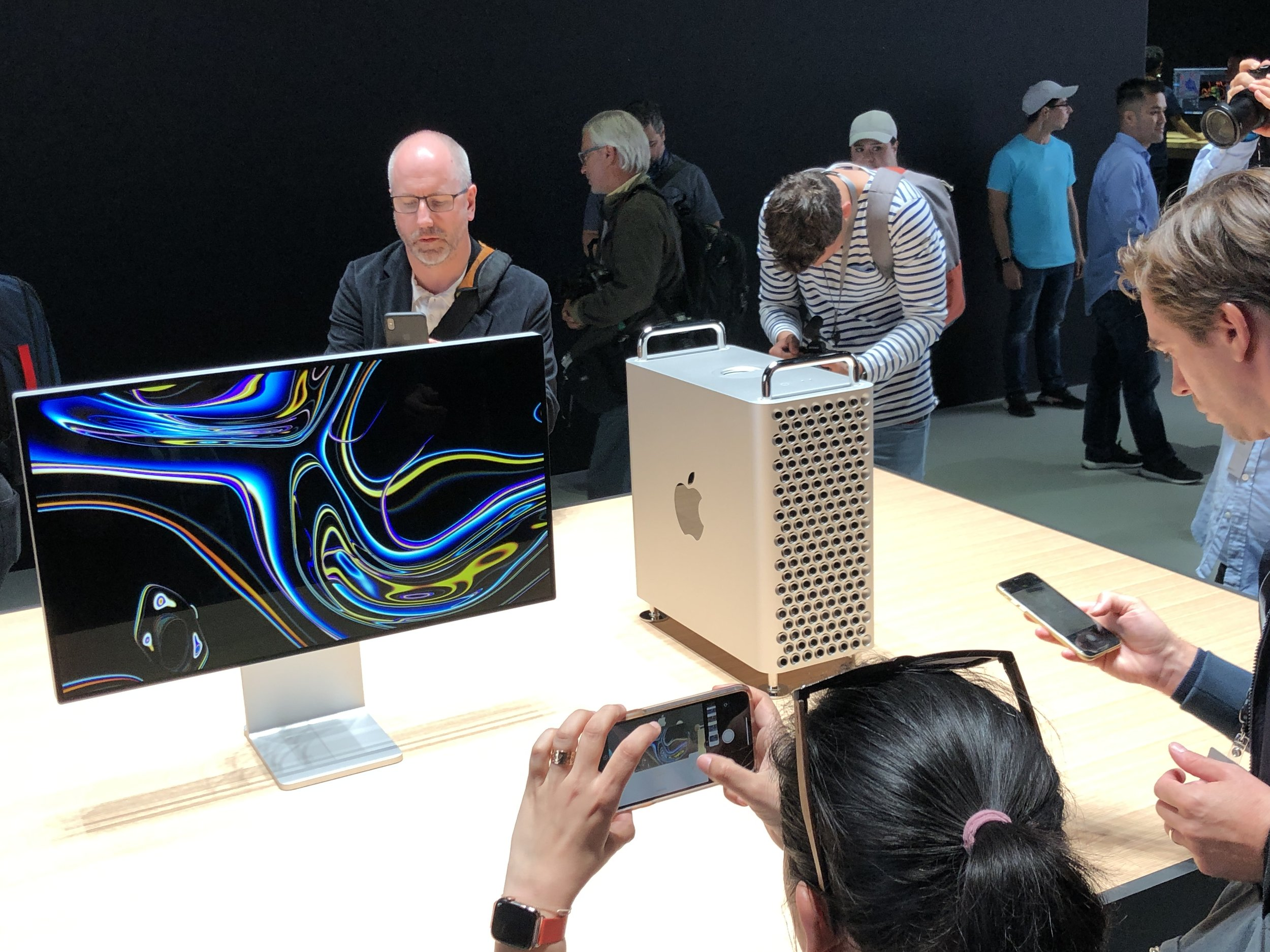 journalists examine the new mac pro and the pro display xdr at WWDC