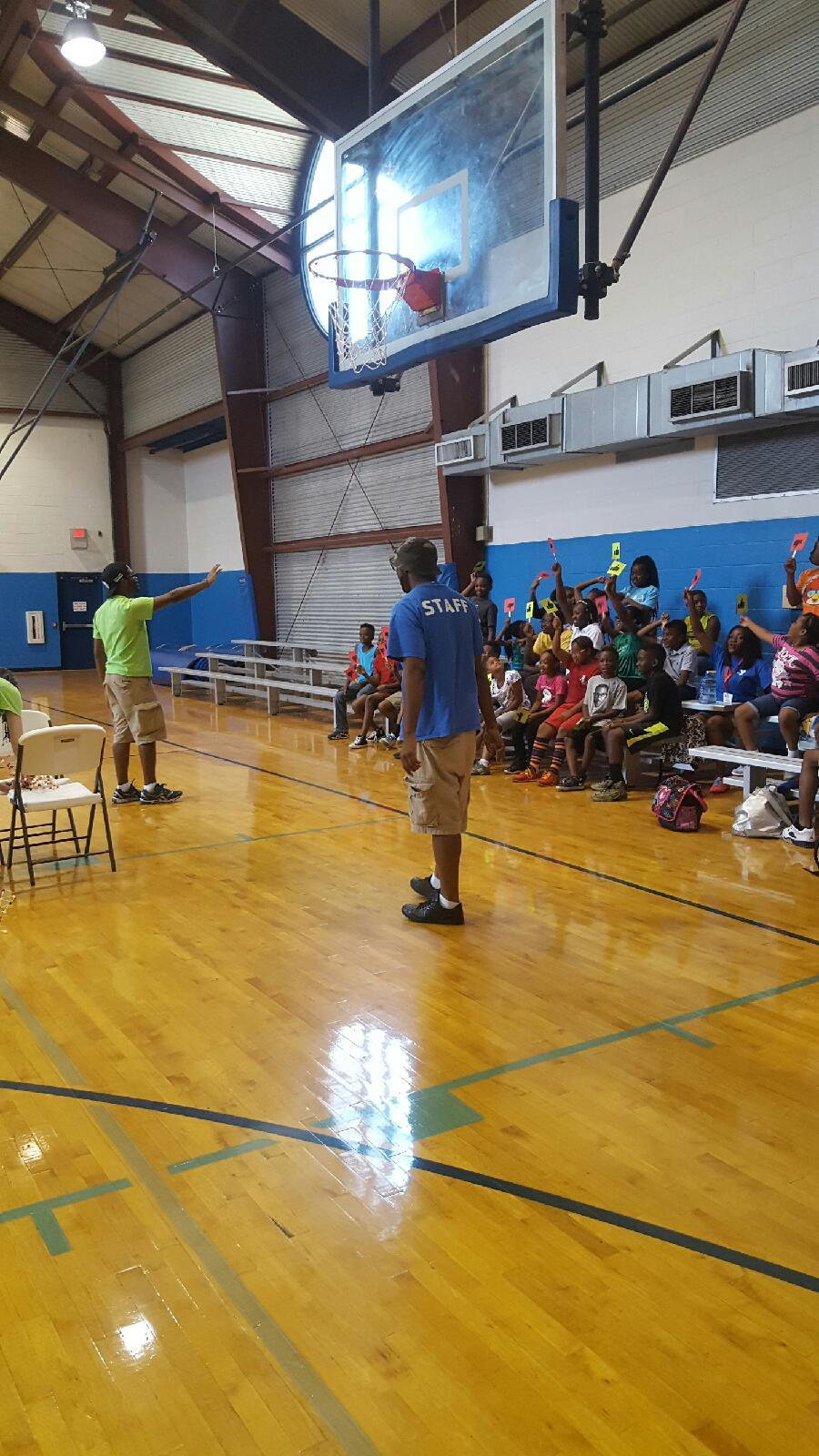 ROW INSTRUCTOR, AMOS DAVIDSON, LEADS THE KIDS THROUGH AN EXPLANATION OF THE OUR WEEK 1 ENGINEERING LESSON.
