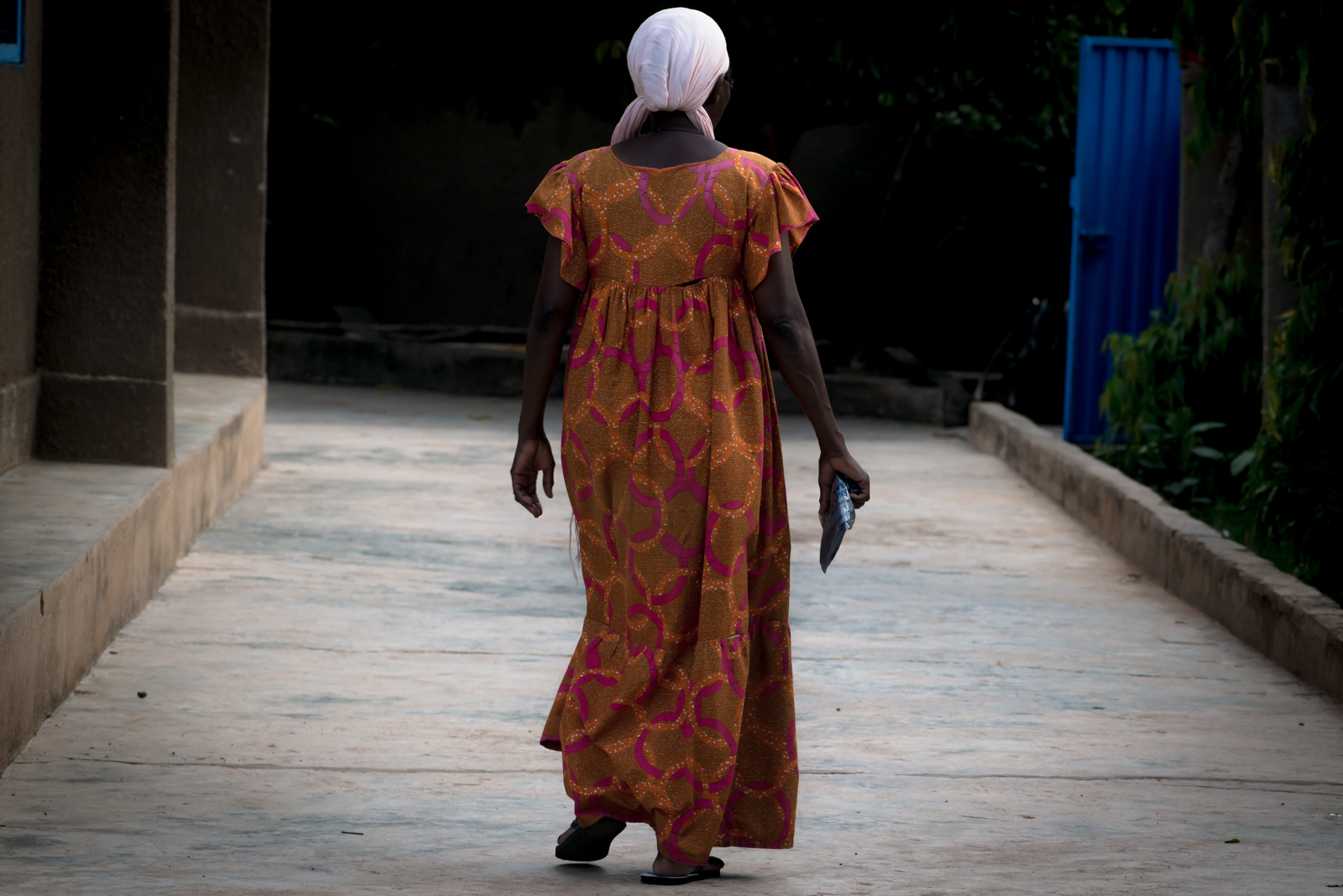 Mama Laadi, the most selfless woman I know, on her way to attend to her children.