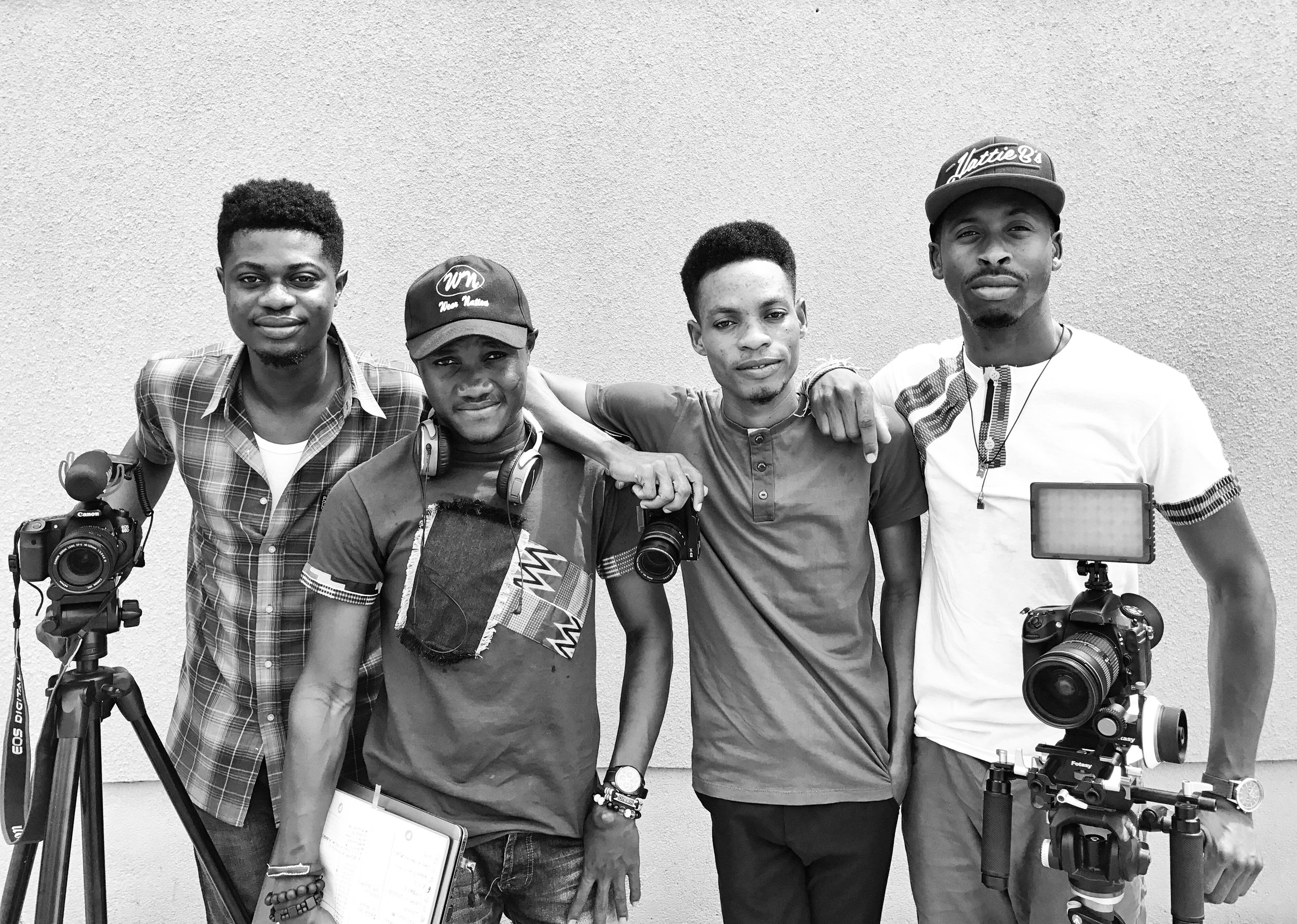 Filming crew on the ground in Ghana On the ground Ghana filming crew. From RIGHT - Isaac Mireku, Abdul Raafiu, Lucas Henry and Louis Bryant III.