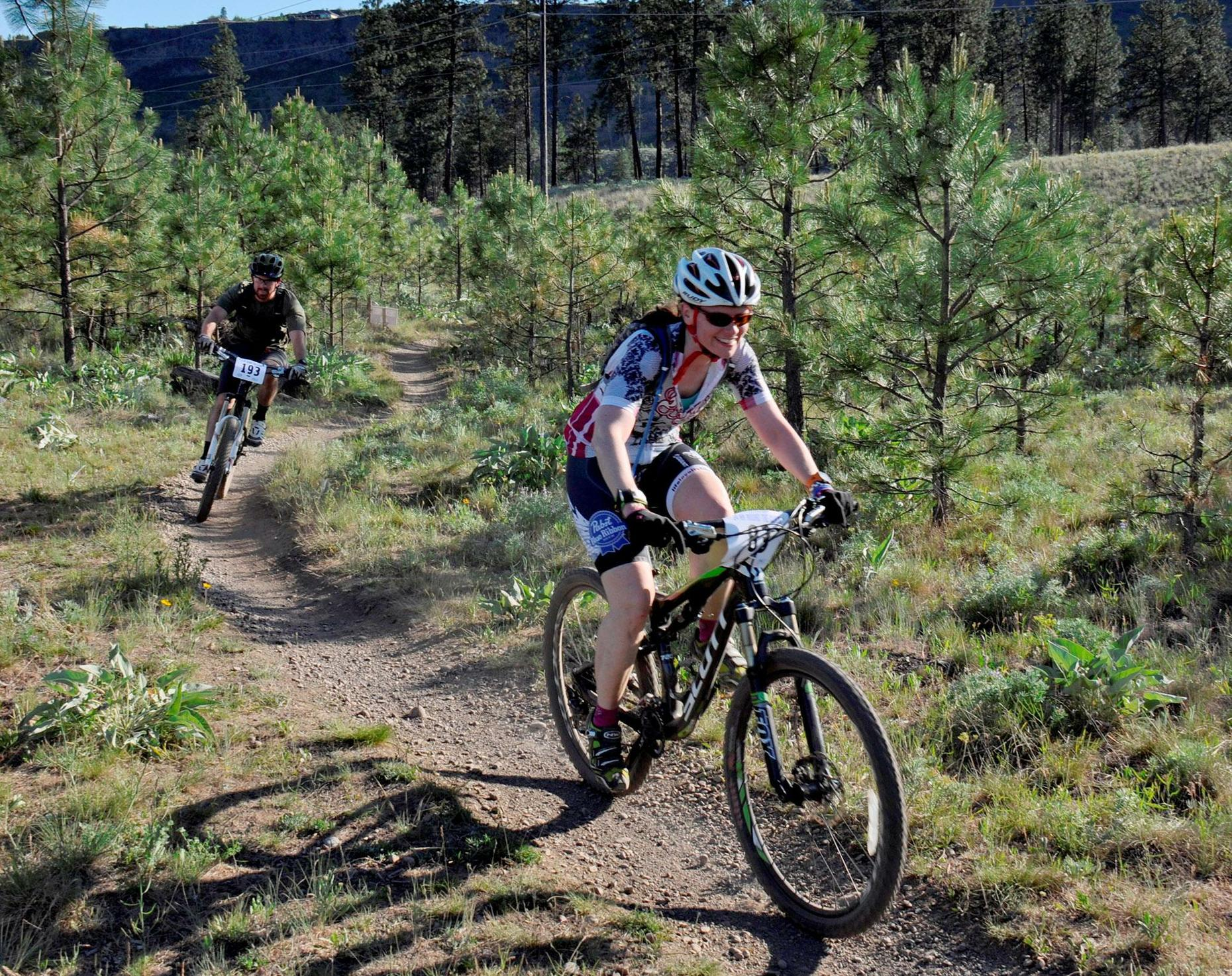 RIDERS CRUSH SOME SINGLE TRACK DURING THE 24 HOURS ROUND THE CLOCK MOUNTAIN BIKE RACE ON MAY 23, 2015, AT RIVERSIDE STATE PARK. (PHOTO COURTESY OF RICH LANDERS RICHL@SPOKESMAN.COM)