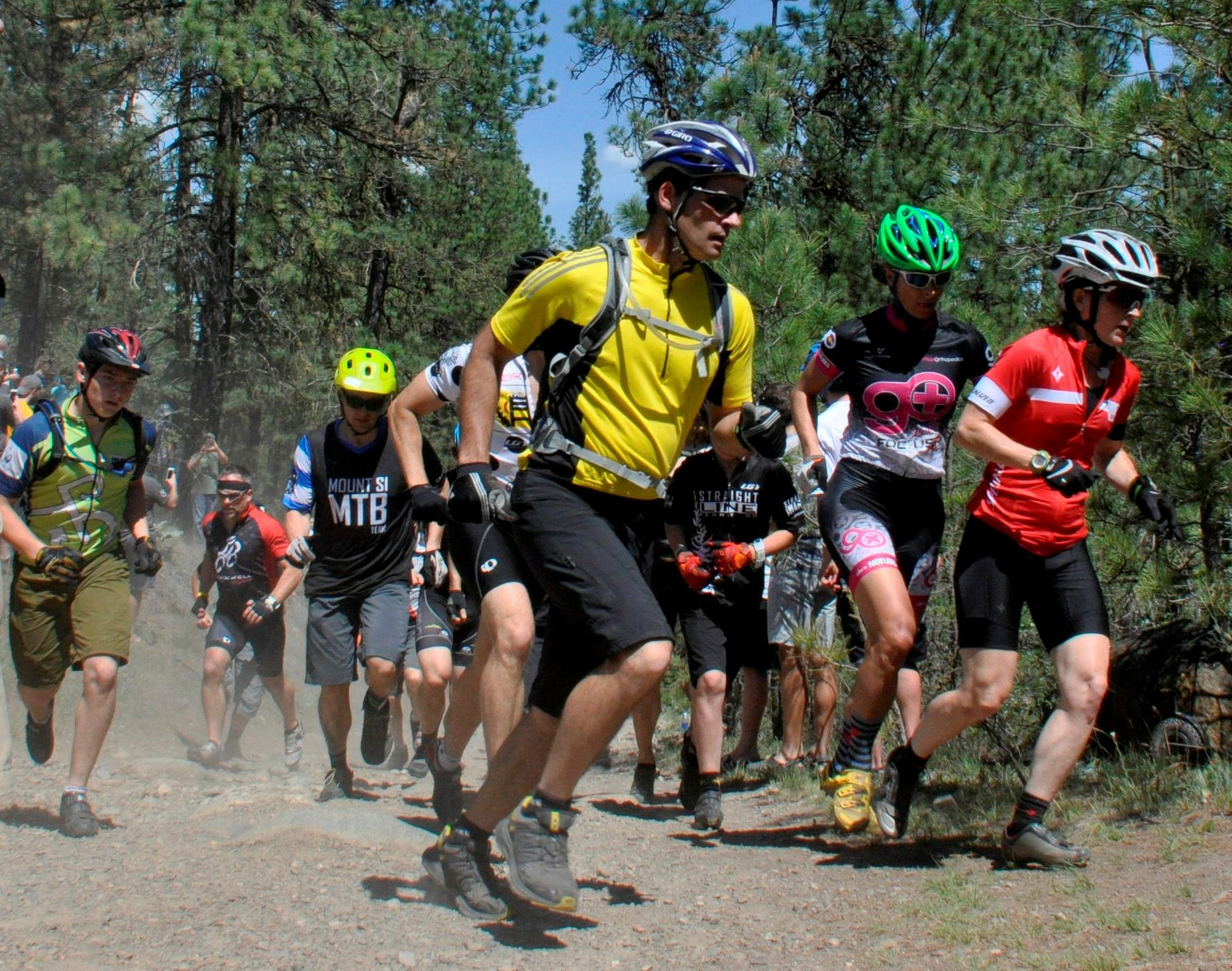Competitors sprint during a running lap to spread out the field before mounting their bikes for the 24 Hours Round the Clock mountain bike race on May 23, 2015, at Riverside State Park. (Photo Courtesy of Rich Landers)