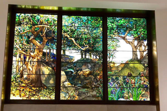 A beautiful and large stained glass window produced by Tiffany.