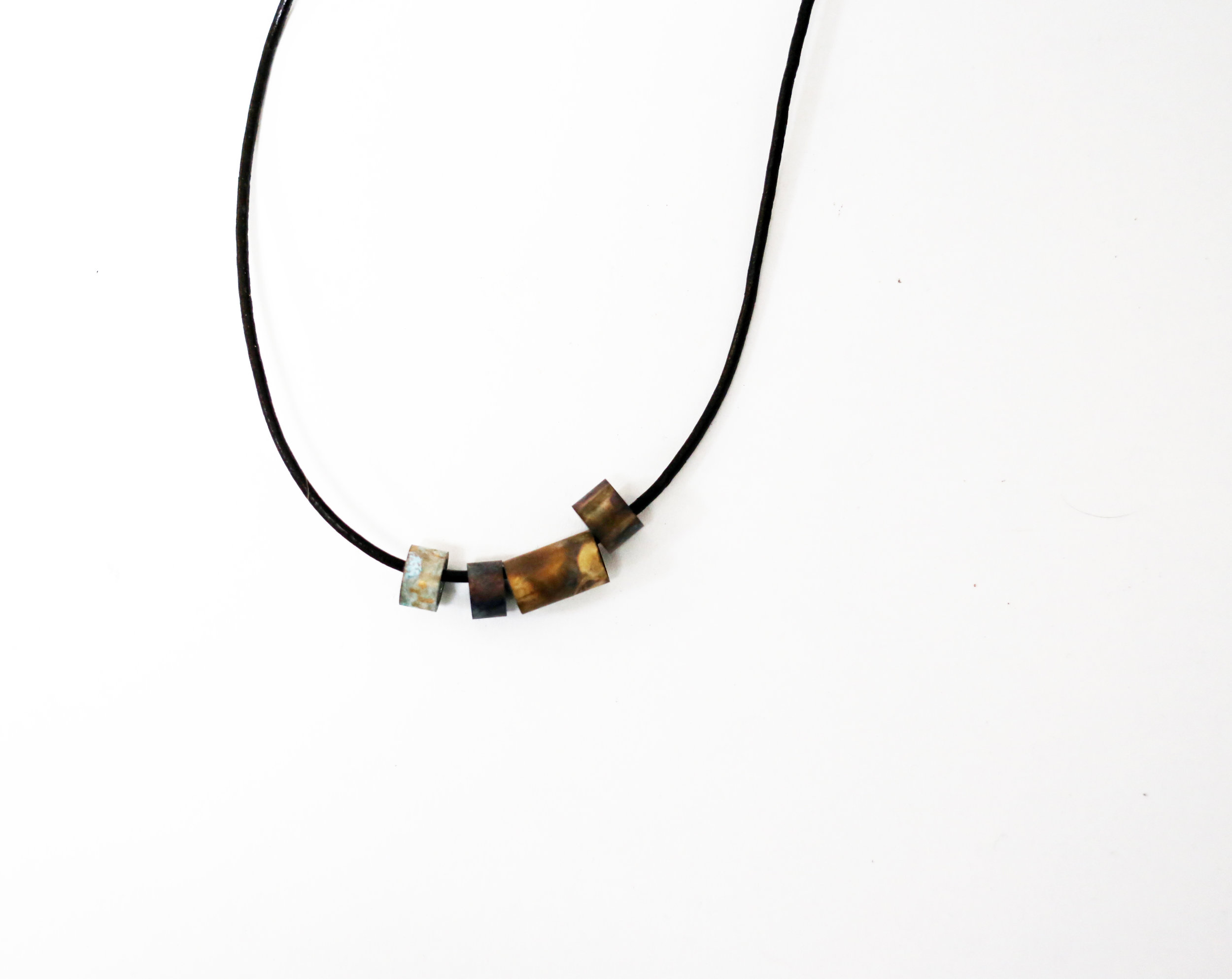 Brass, Aluminum, Seawater patina, Leather cord
