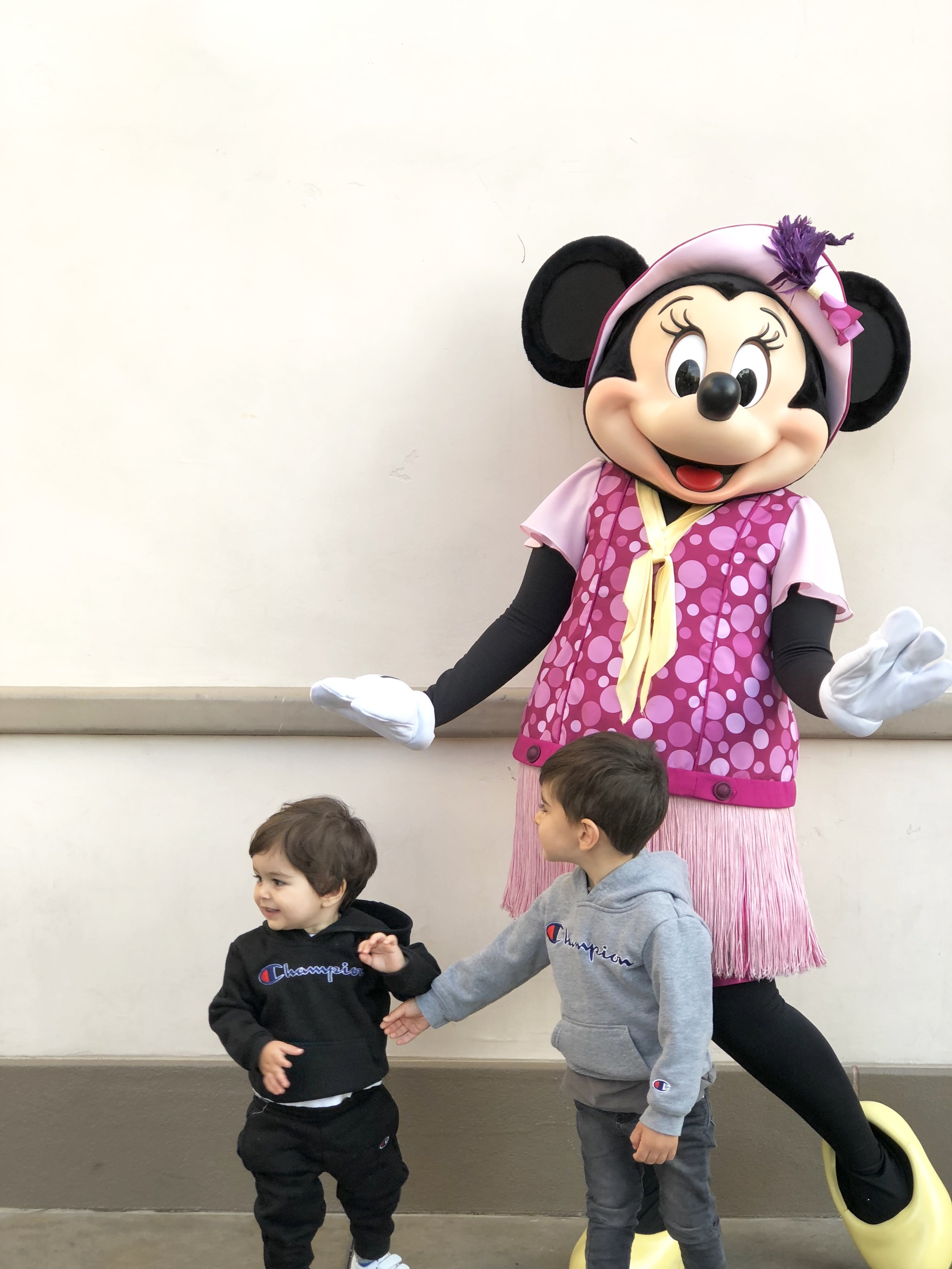 Ryan and Leo meet Minnie Mouse.