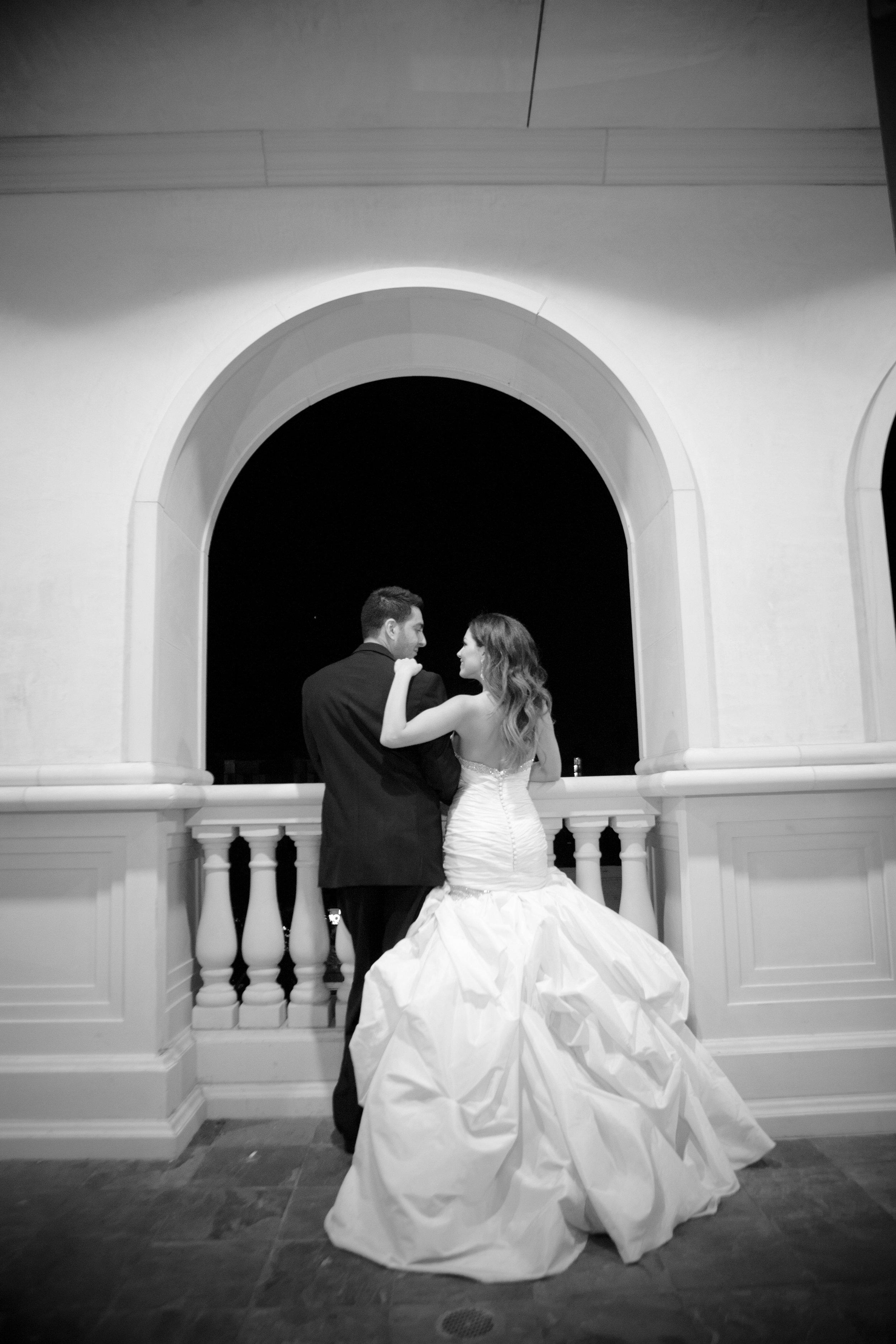 Bride in mermaid wedding dress with groom on wedding day