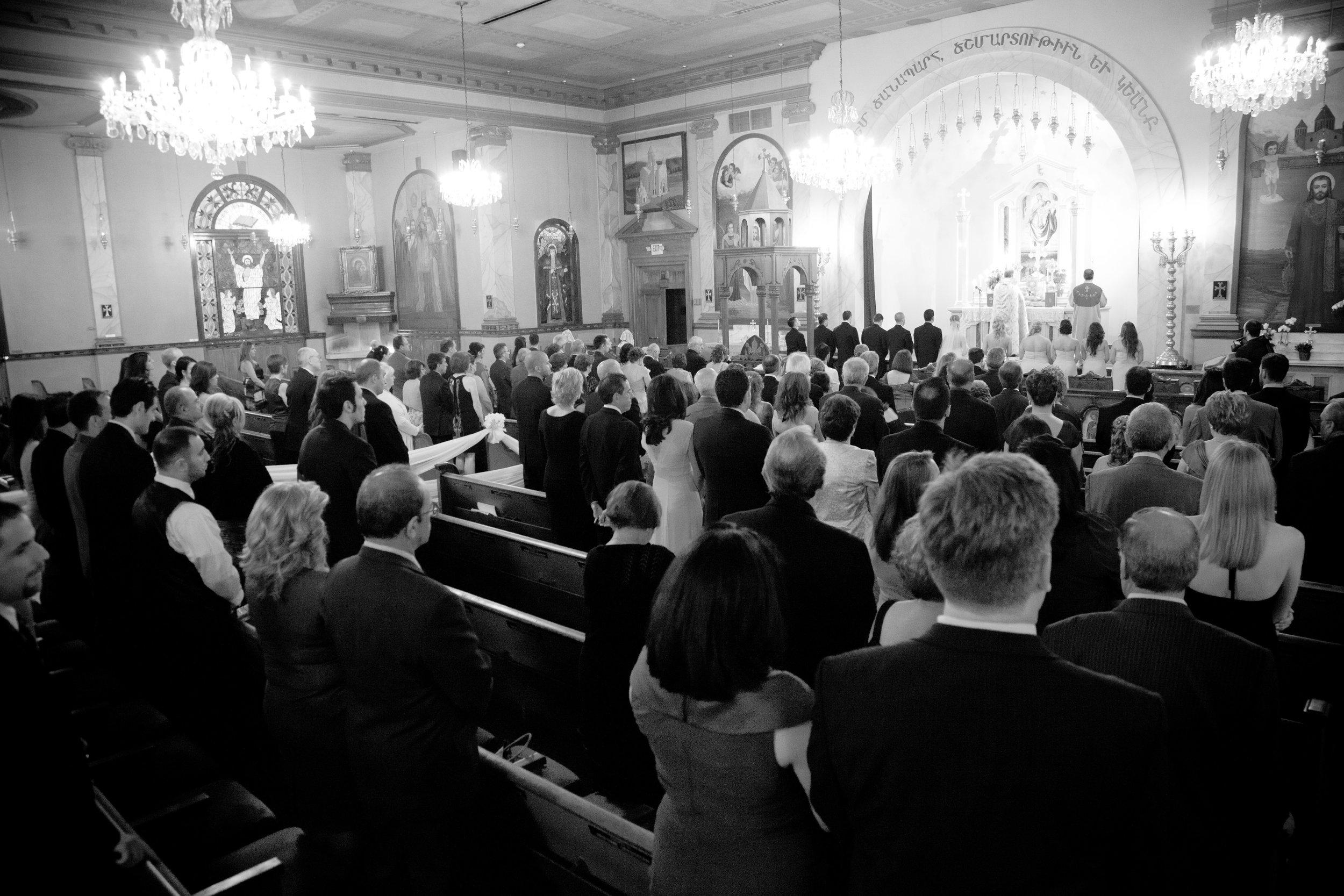 Catholic Church congregation during wedding ceremony