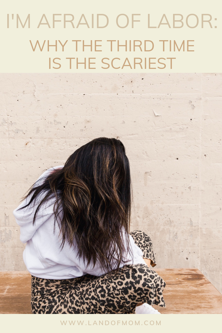 """Pinterest Graphic for """"I'm Afraid of Labor: Why the Third Time is the Scariest."""" Image of El Abad sitting cross-legged wearing leopard print pants, white hoodie, and white sneakers. Hair draped covering face."""