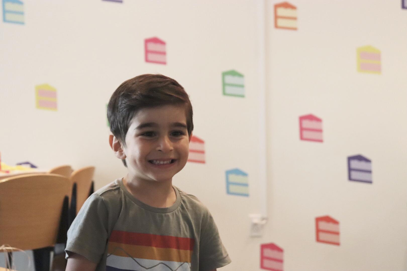 El Abad's oldest son, Ryan, smiling. Land of Mom.